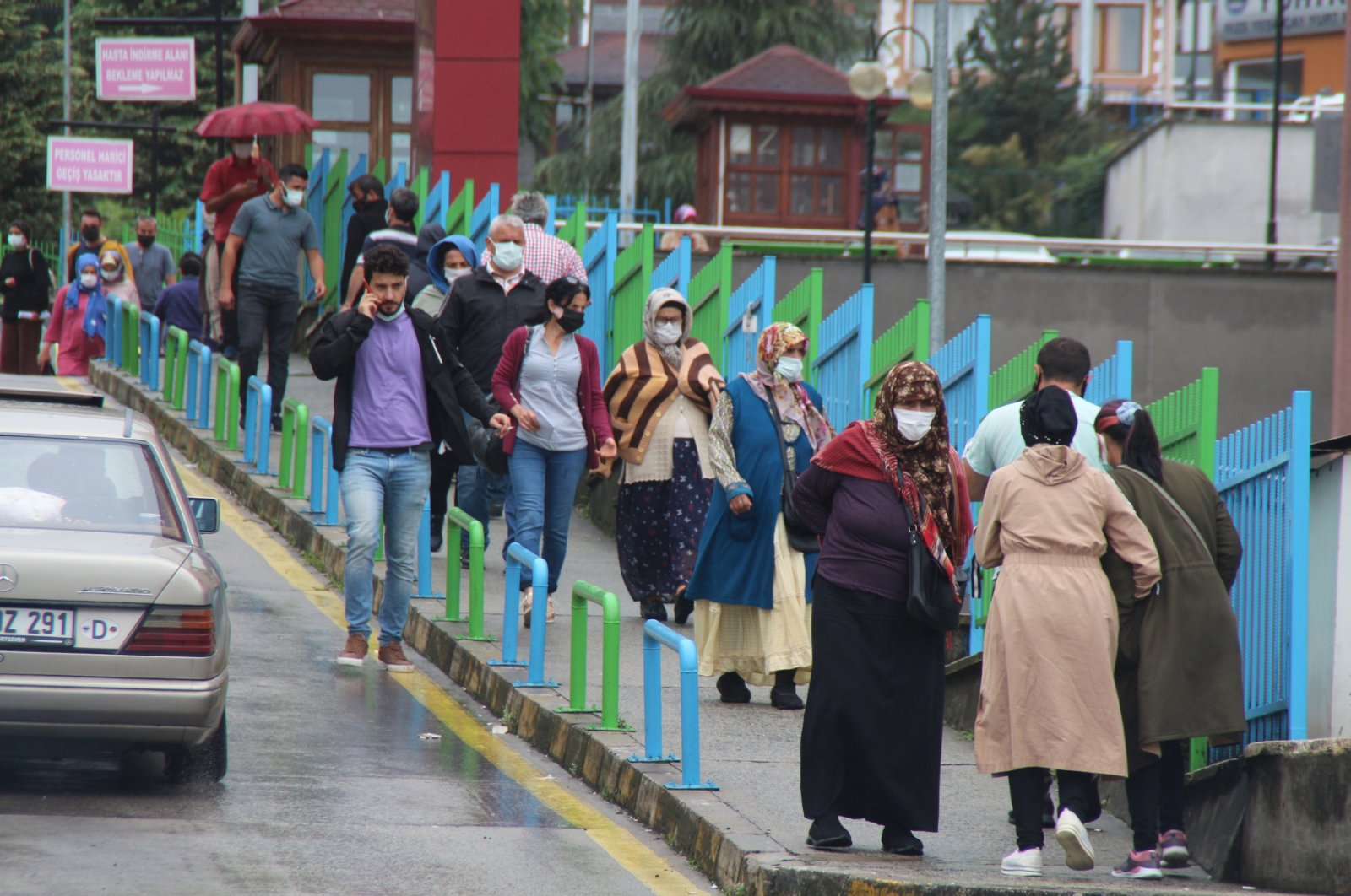 People wearing protective masks walk on a street, in Rize, northern Turkey, Sept. 6, 2021. (DHA PHOTO)