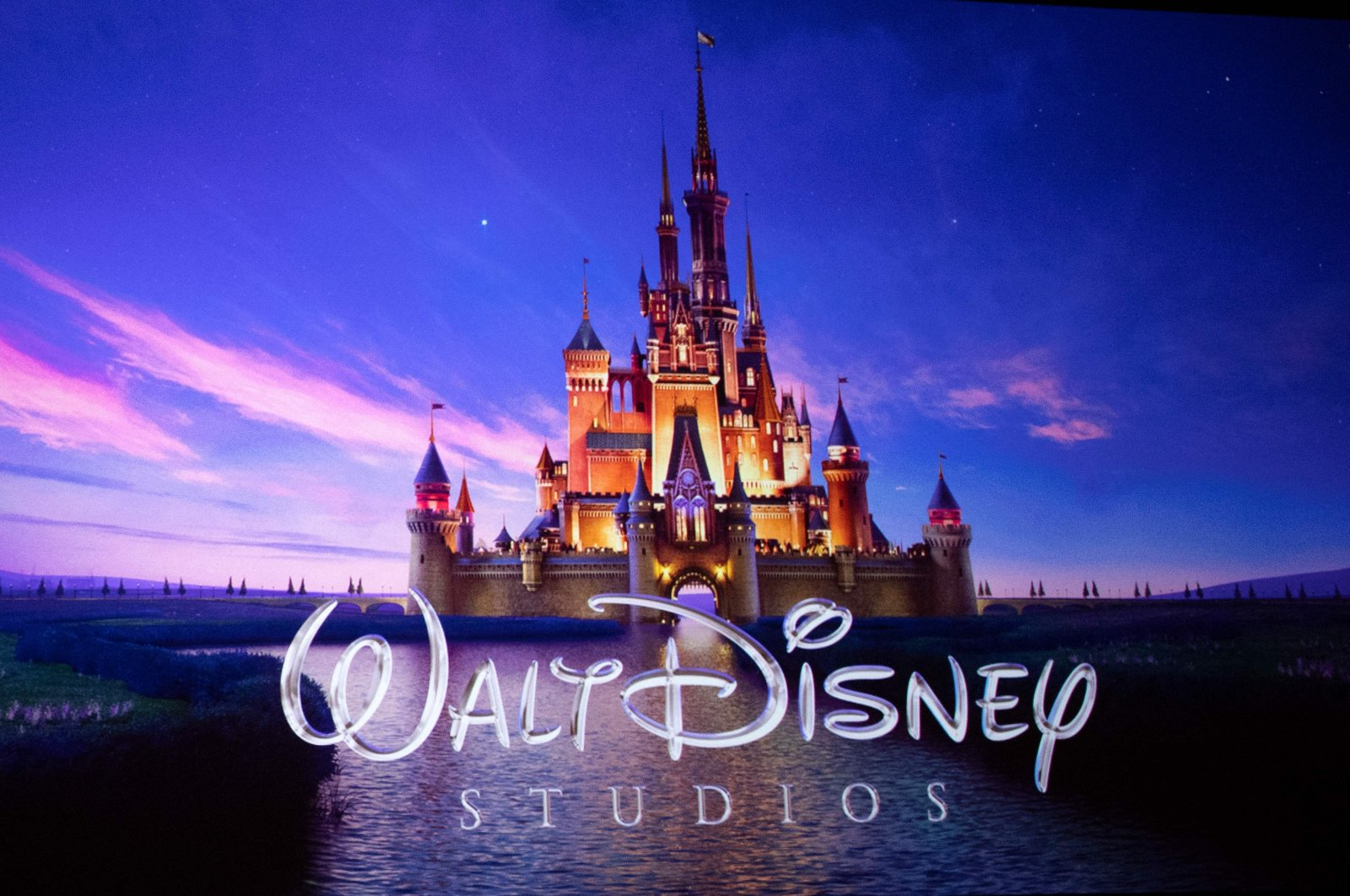The Walt Disney Studios logo is projected onscreen during the CinemaCon Walt Disney Studios Motion Pictures Special presentation at the Colosseum Caesars Palace, in Las Vegas, Nevada, U.S., April 3, 2019. (AFP Photo)