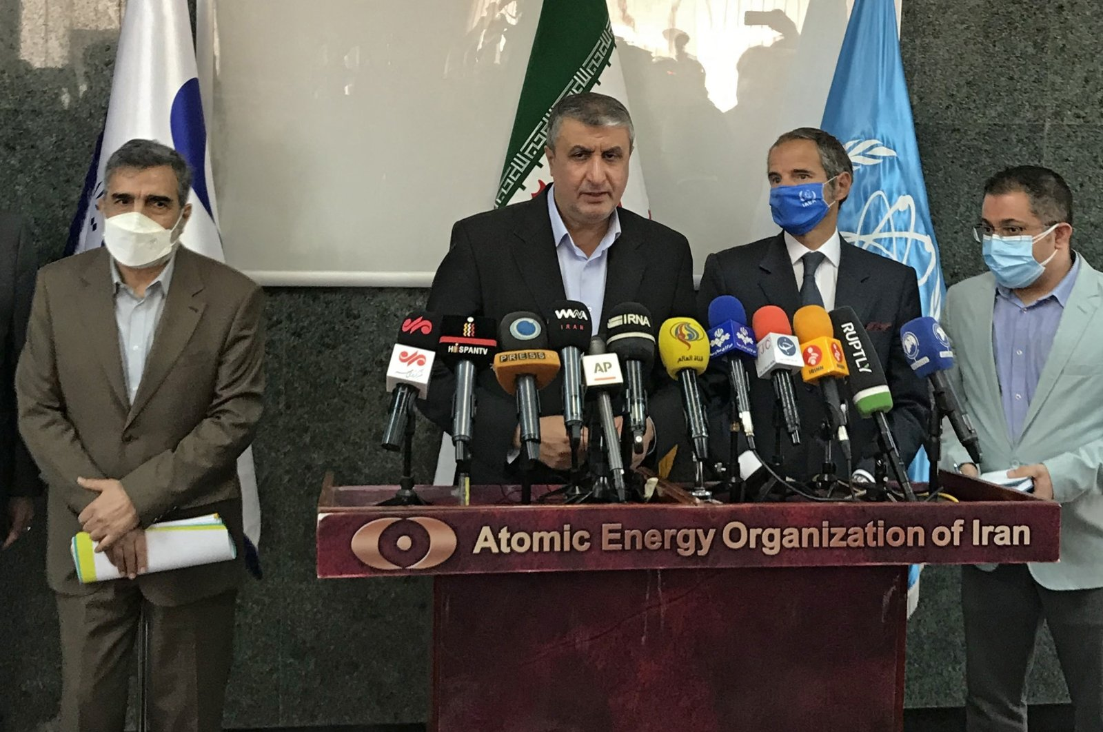 Atomic Energy Organization of Iran (AEOI) head Mohammad Eslami (C) delivers a speech next to Director General of the International Atomic Energy Agency (IAEA) Rafael Grossi (2-R) and AEOI spokesperson Behrouz Kamalvandi in Tehran, Iran, Sept. 12, 2021. (AEOI handout photo via AFP)