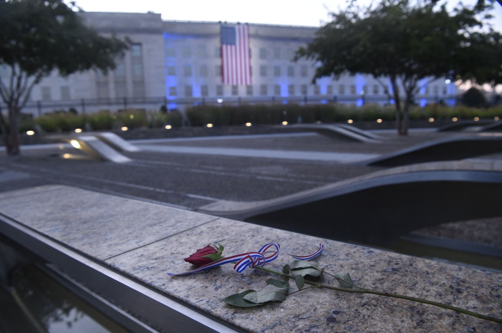 An American flag hangs from the side of the Pentagon to commemorate the 20th anniversary of the 9/11 attacks, as seen from the Pentagon 9/11 Memorial, in Washington, D.C., U.S, Sept. 11, 2021. (AFP Photo)