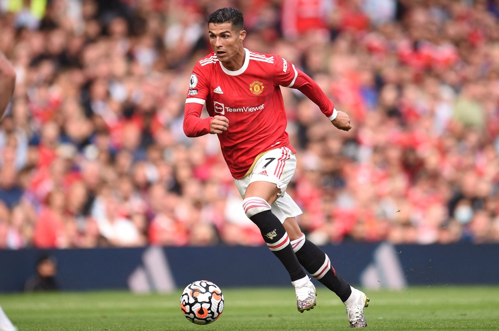 Manchester United's Cristiano Ronaldo runs with the ball during a Premier League match against Newcastle at Old Trafford in Manchester, England, Sept. 11, 2021. (AFP Photo)