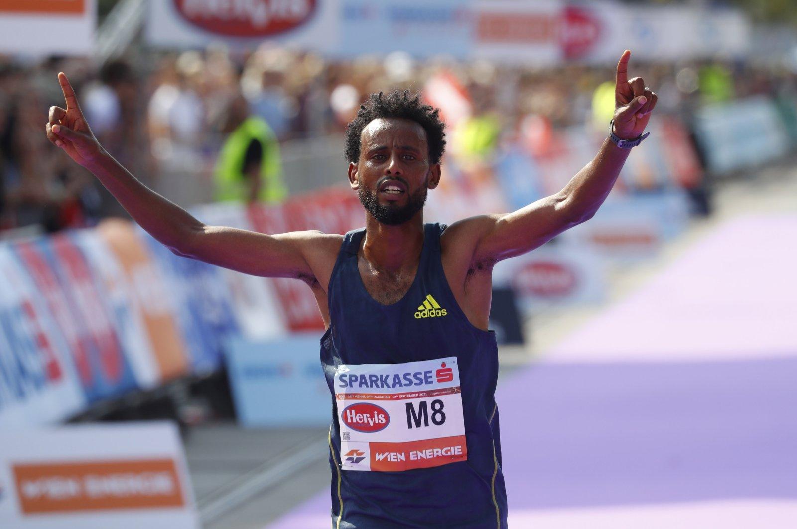 Ethiopia's Derara Hurisa celebrates after winning the Vienna City Marathon in Vienna, Austria, Sept. 12, 2021.