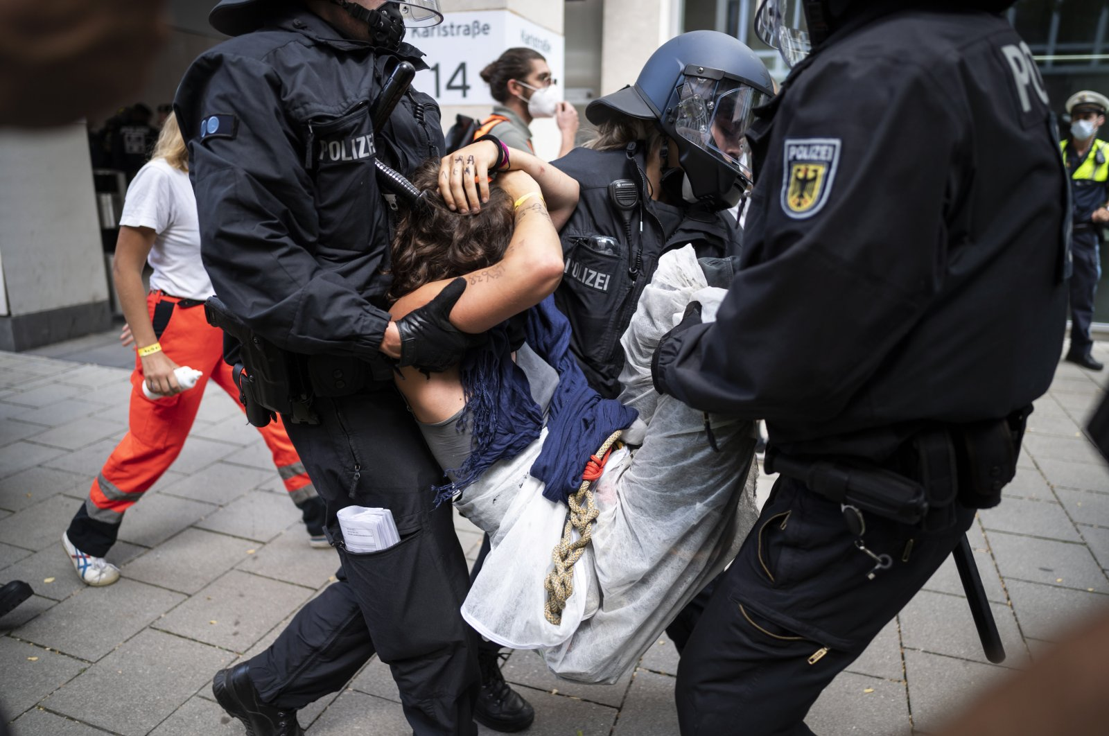 Riot police carry away a demonstrator during a protest against the International Motor Show (IAA) in Munich, Germany, Sept. 10, 2021. (EPA Photo)
