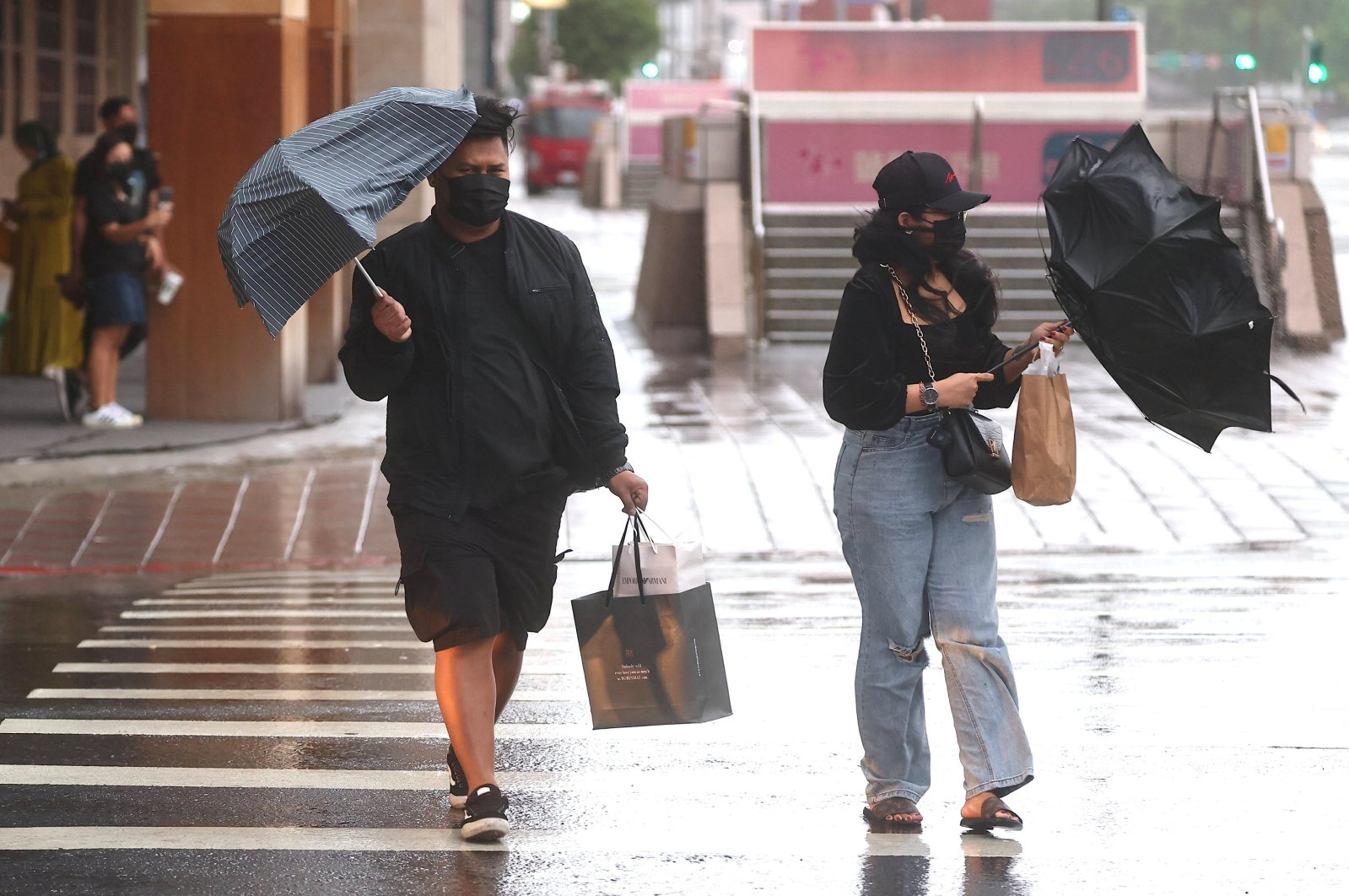 People walk in strong wind and rain caused by Typhoon Chanthu in Taipei, Taiwan, Sept. 12, 2021. (Reuters Photo)