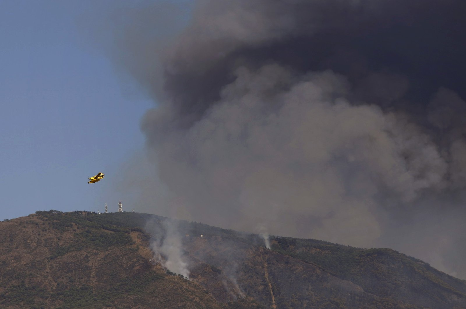 Hydroplanes operate on a wildfire in Estepona, in Malaga province, Spain, Sept. 11, 2021.  (AP Photo)