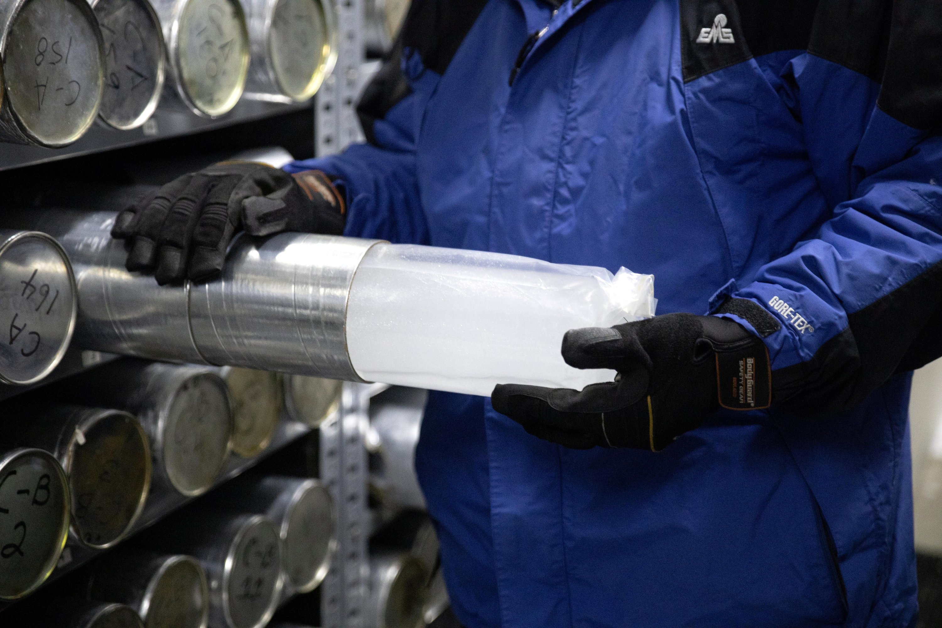 Lonnie Thompson, professor and research scientist at Ohio State University, holds an ice core sample from a glacier in the Byrd Polar and Climate Research Center in Columbus, Ohio, U.S., Jan. 15, 2021. (Reuters Photo)