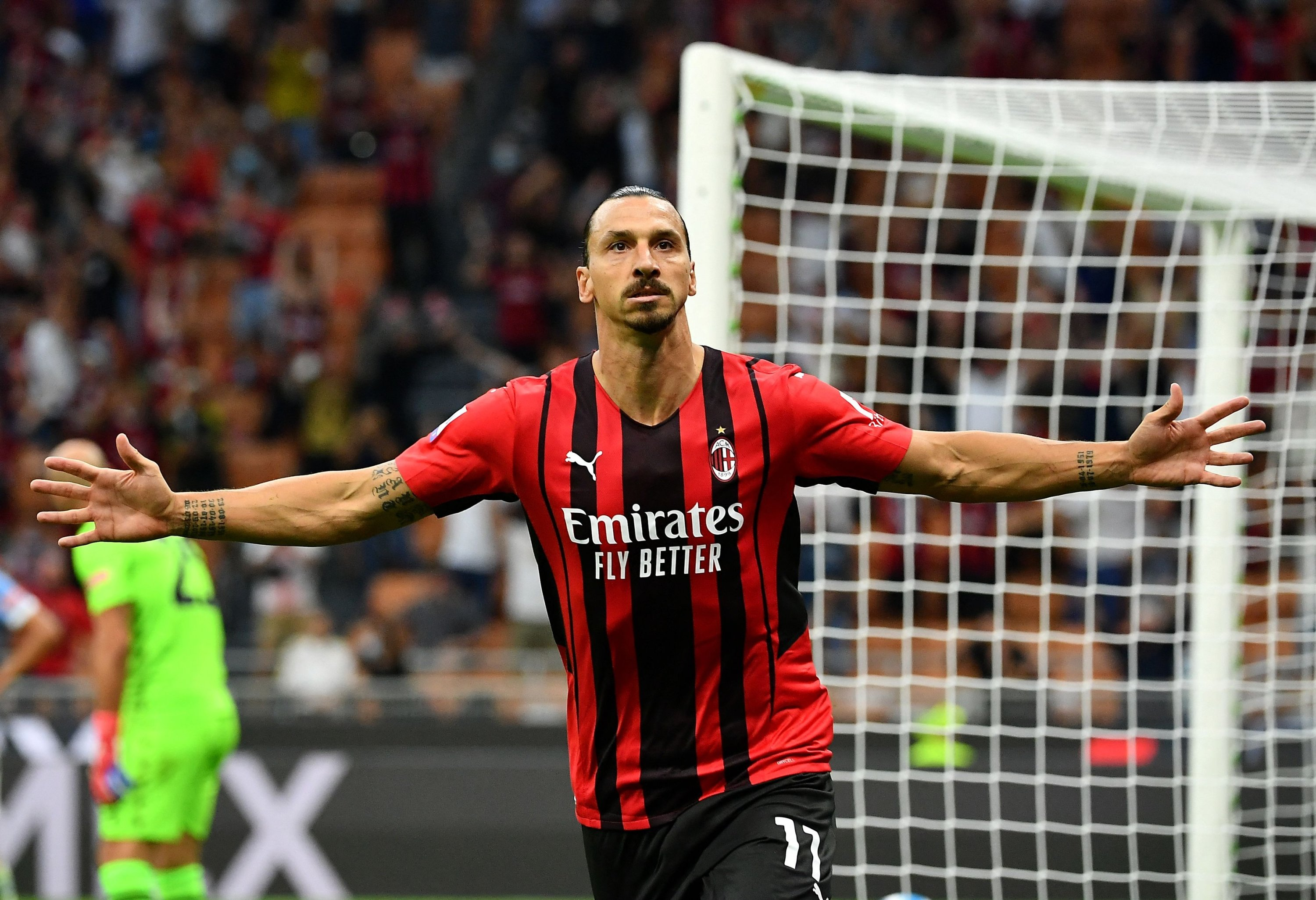 AC Milan's Swedish forward Zlatan Ibrahimovic celebrates after scoring in a Serie A match against Lazio at the San Siro, Milan, Italy, Sept. 12, 2021. (AFP Photo)