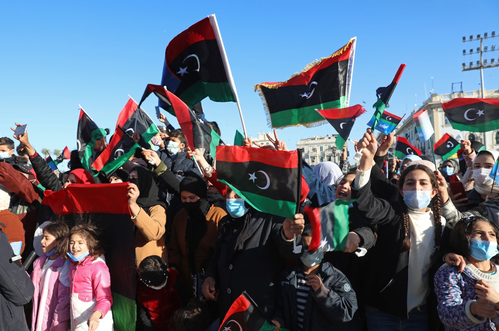 Libyans mark the 10th anniversary of their 2011 uprising that led to the overthrow and killing of longtime ruler Moammar Gadhafi, in Martyrs Square, Tripoli, Libya, Feb. 17, 2021. (AP File Photo)