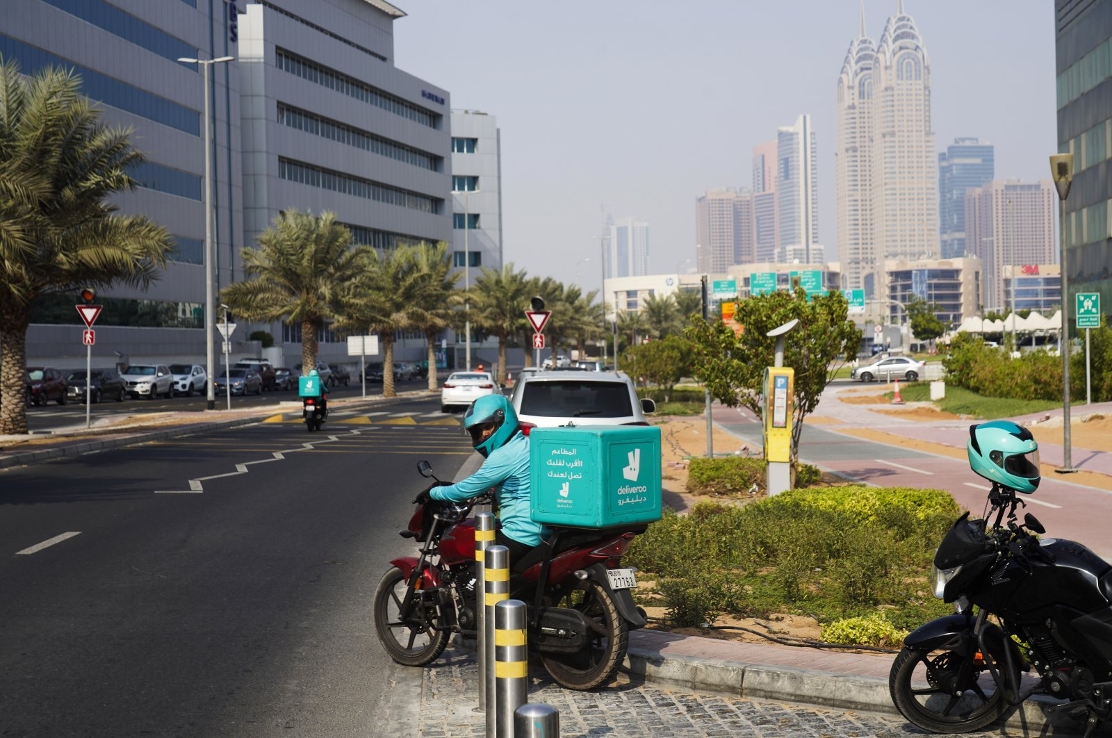 A delivery driver for the app Deliveroo prepares to make a delivery, in Dubai, United Arab Emirates, Sept. 9, 2021. (AP Photo)