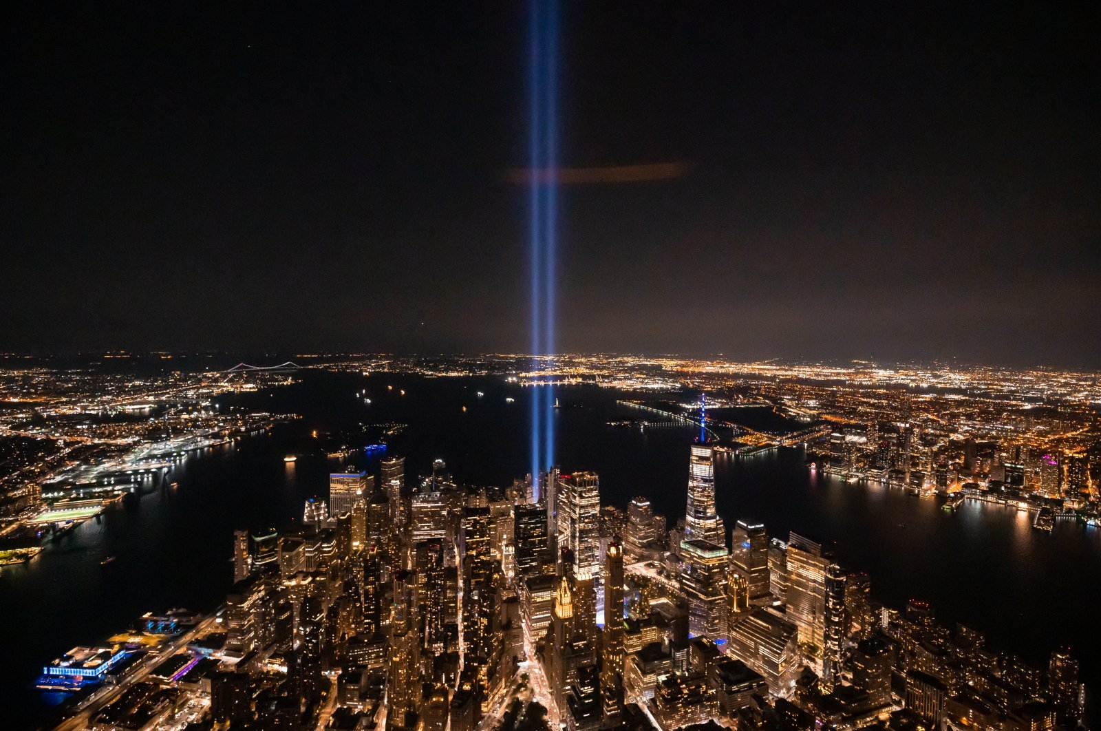 """A view of New York City and the """"Tribute In Light,"""" marking the 20th anniversary of the 9/11 terrorist attacks at the World Trade Center, in New York City, U.S., Sept. 11, 2021. (Photo by Getty Images)"""