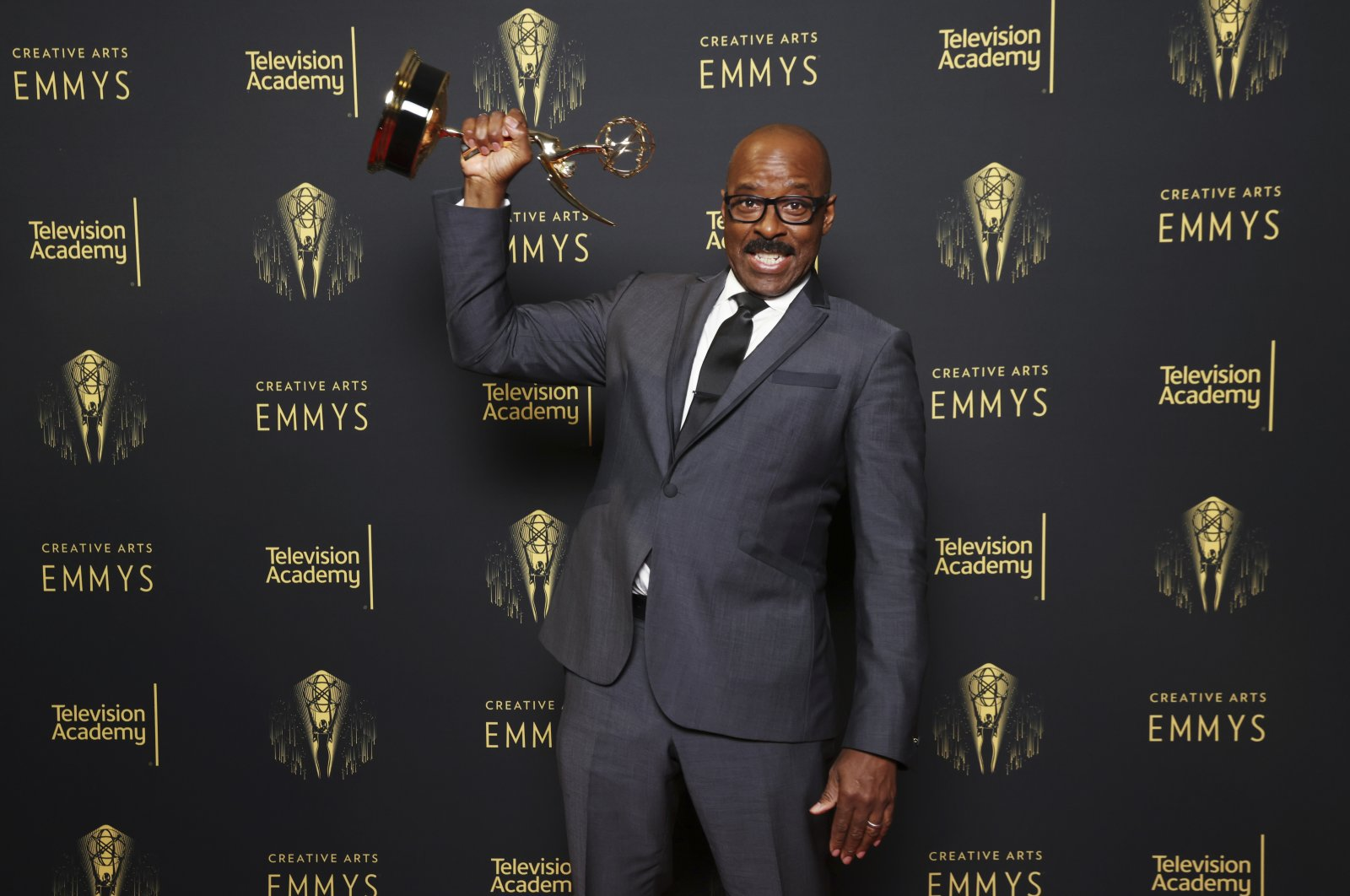"""Courtney B. Vance, winner of the Emmy for outstanding guest actor in a drama series for the """"Whitey's on the Moon"""" episode of """"Lovecraft Country,"""" poses for a portrait during the third ceremony of the Television Academy's 2021 Creative Arts Emmy Awards at the L.A. LIVE Event Deck on Sunday, Sept. 12, 2021, in Los Angeles. (AP Photo)"""