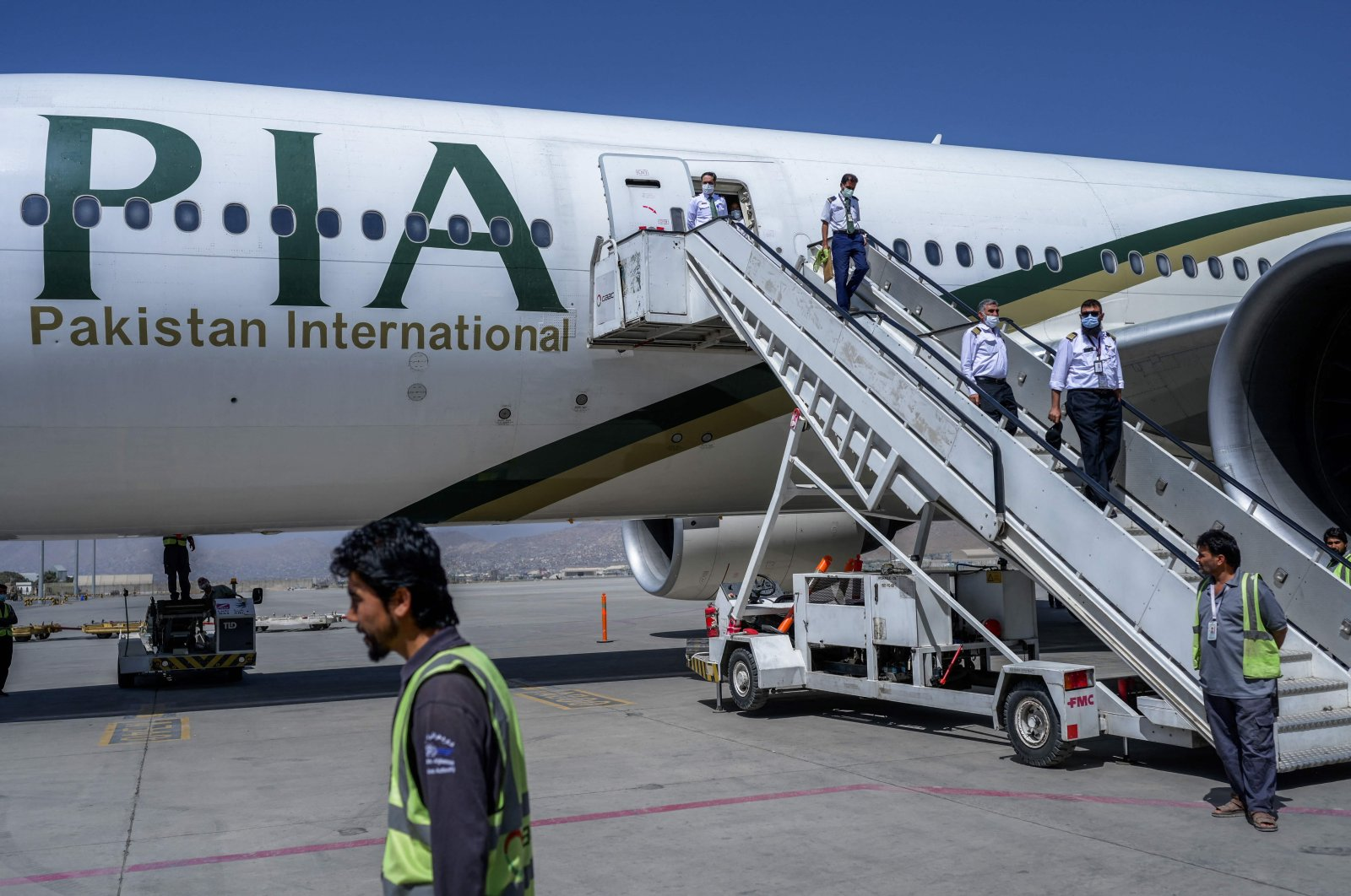 Crew members disembark from a Pakistan International Airways (PIA) flight, the first commercial international flight since the Taliban retook power last month, at Kabul airport, Afghanistan, Sept. 13, 2021. (AFP Photo)