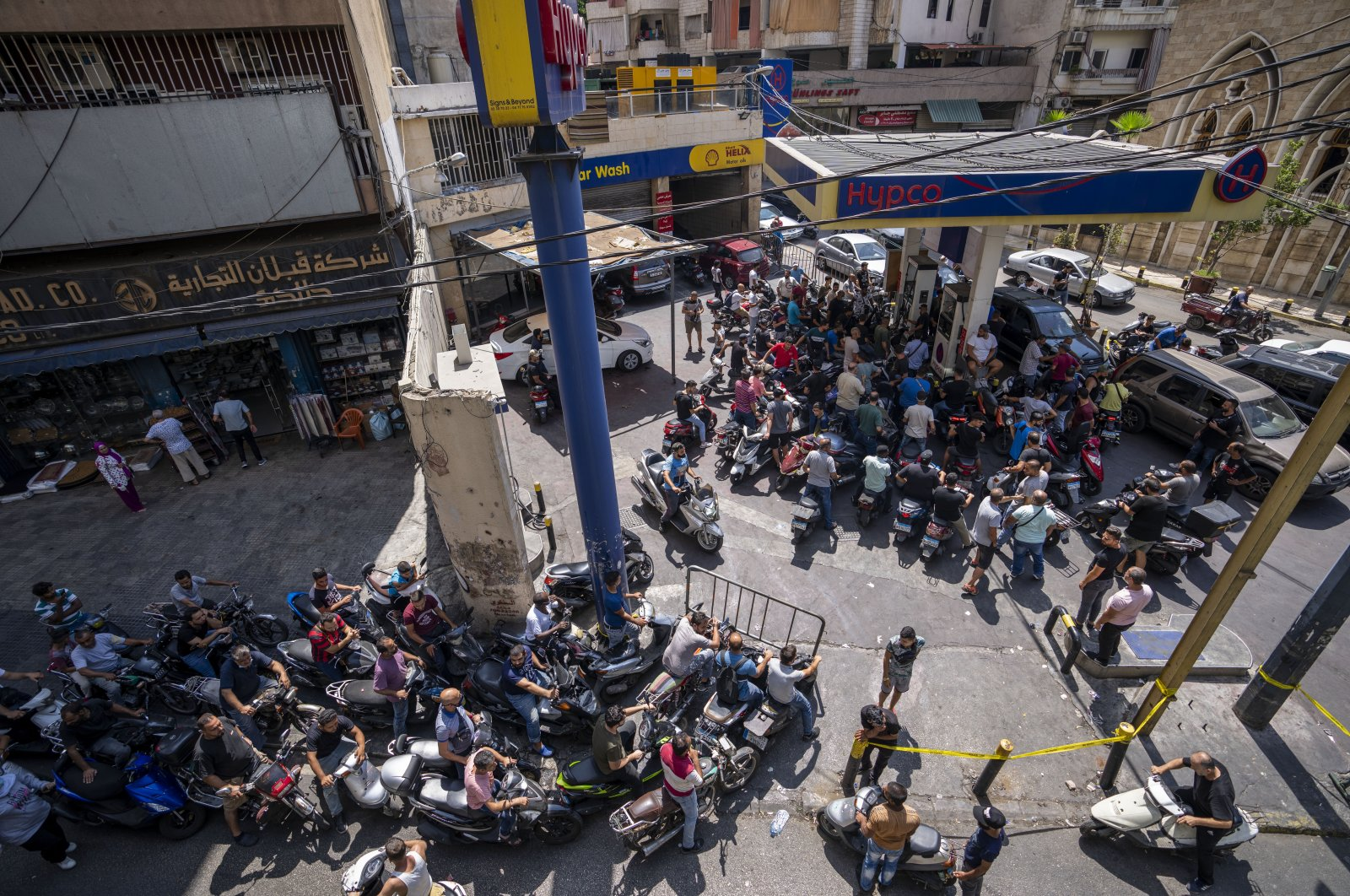 Motorcycle drivers wait to get fuel at a gas station in Beirut, Lebanon, Aug. 31, 2021. (AP Photo)