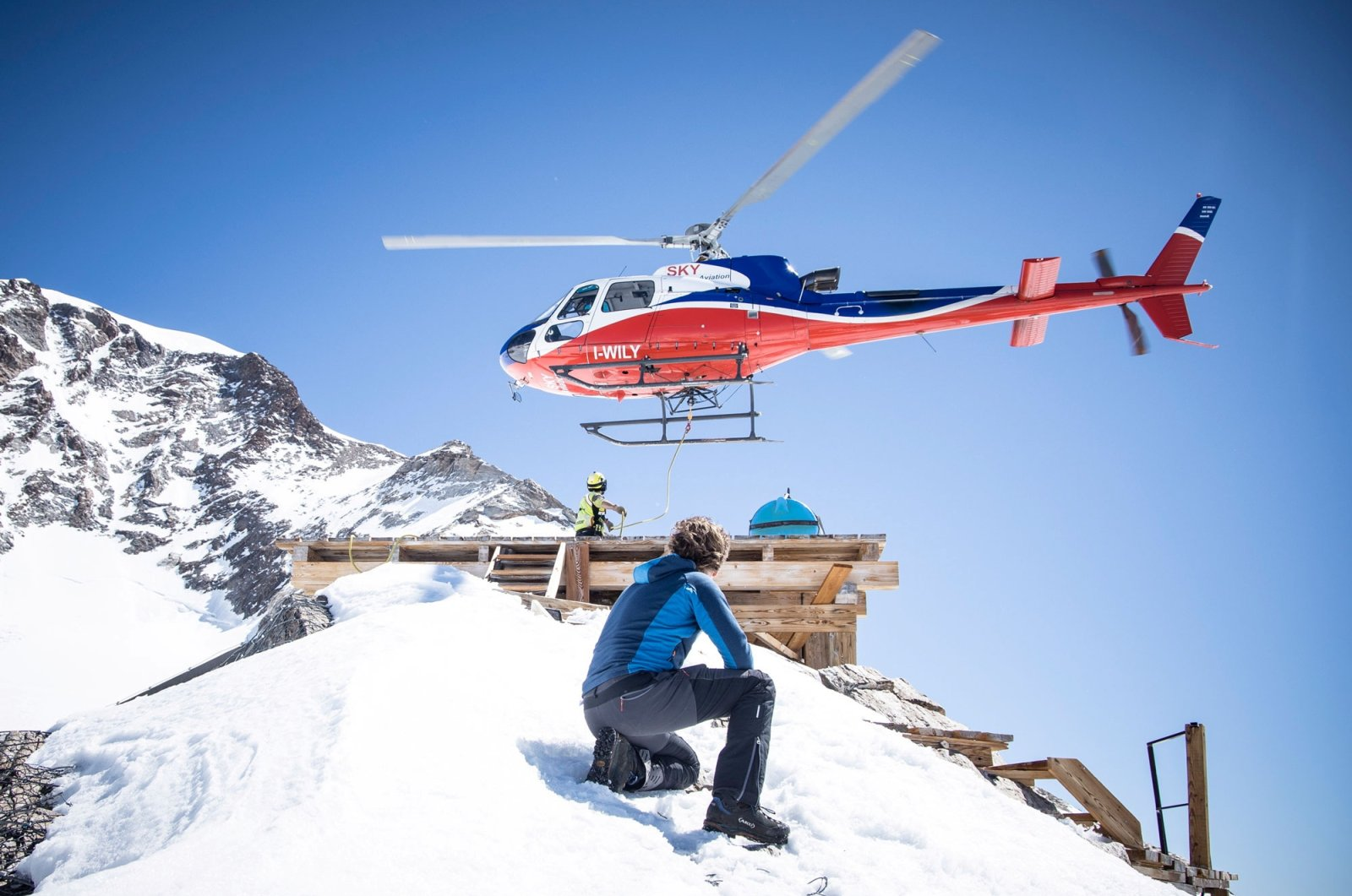 Scientists wait at 3,600 meters at a camp used to acclimatize on a mission to the Colle Gnifetti glacier on the summit of the Alps' Monte Rosa to harvest ice cores in June 2021. (Reuters Photo)