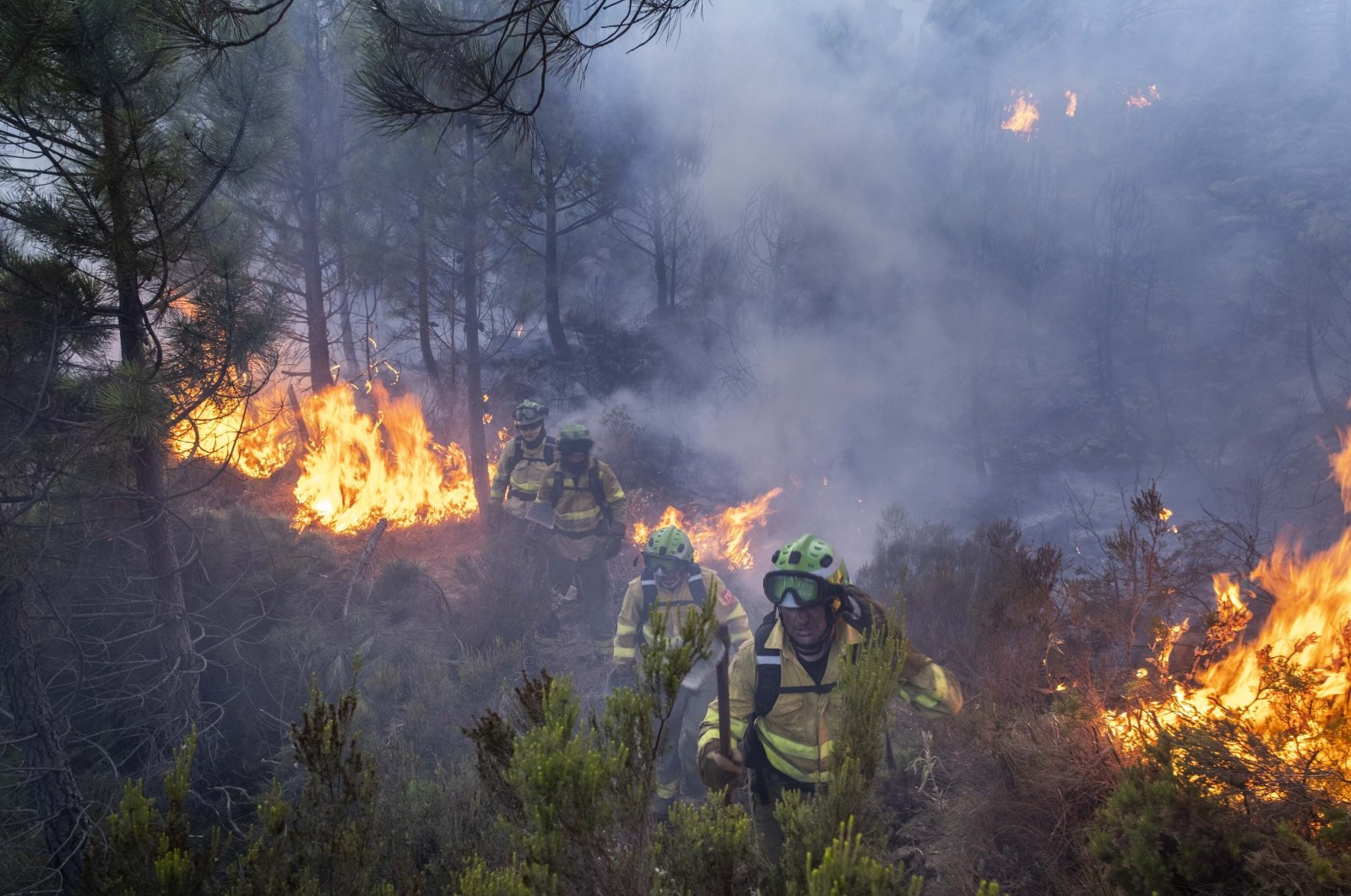 Forest firefighters work on a wildfire near the town of Jubrique, in Malaga province, Spain, Sept. 11, 2021.  (AP Photo)