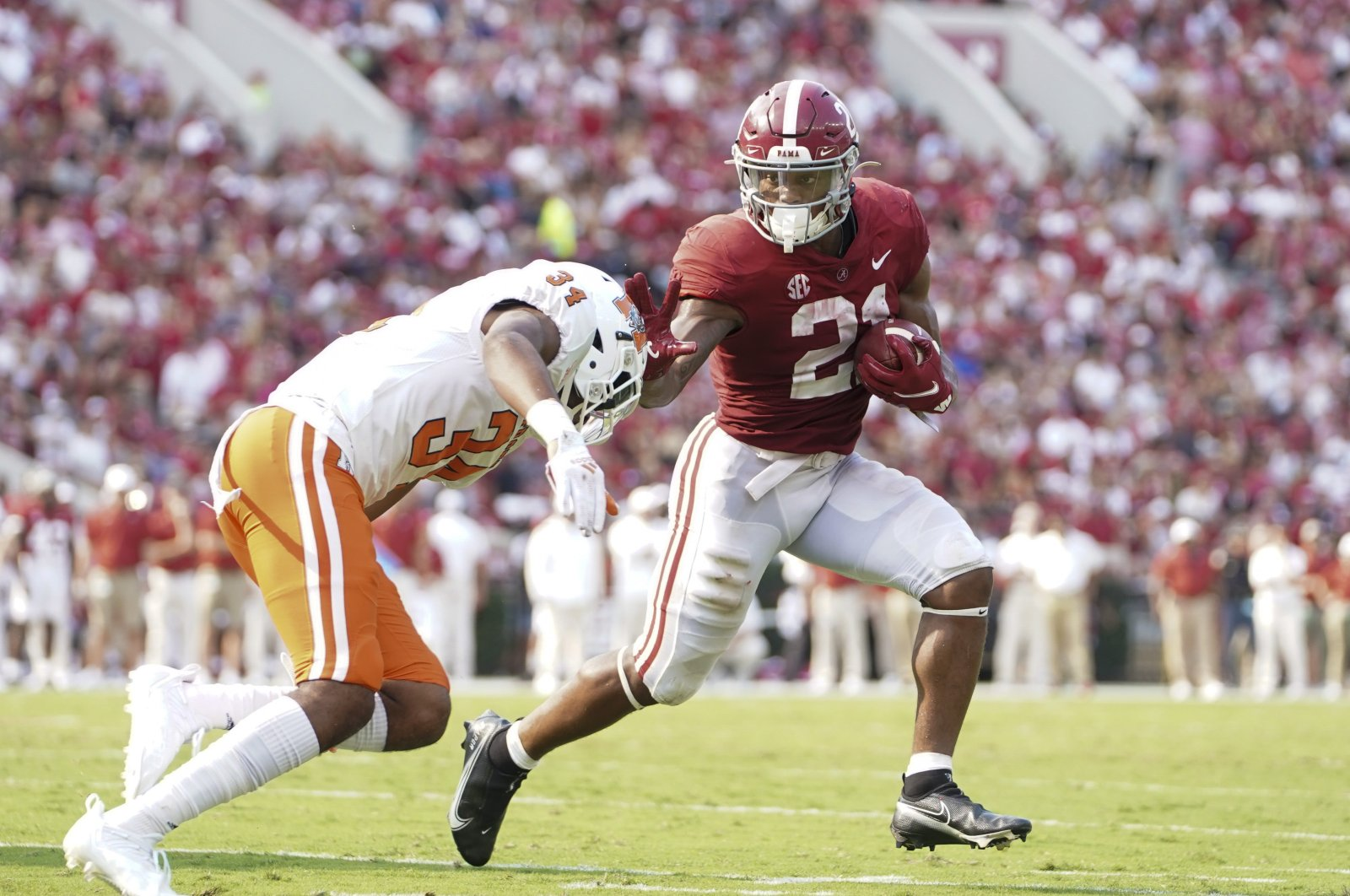 Alabama Crimson Tide running back Jase McClellan (21) pushes away Mercer Bears safety Myles Redding (34) at Bryant-Denny Stadium,Tuscaloosa, Alabama, U.S., Sept. 11, 2021. (Marvin Gentry-USA TODAY Sports via Reuters)