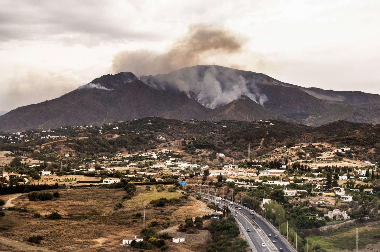 Smoke rises over smoking mountains near the town of Jubrique, in Malaga province, Spain, Sept. 13, 2021. (AP Photo)