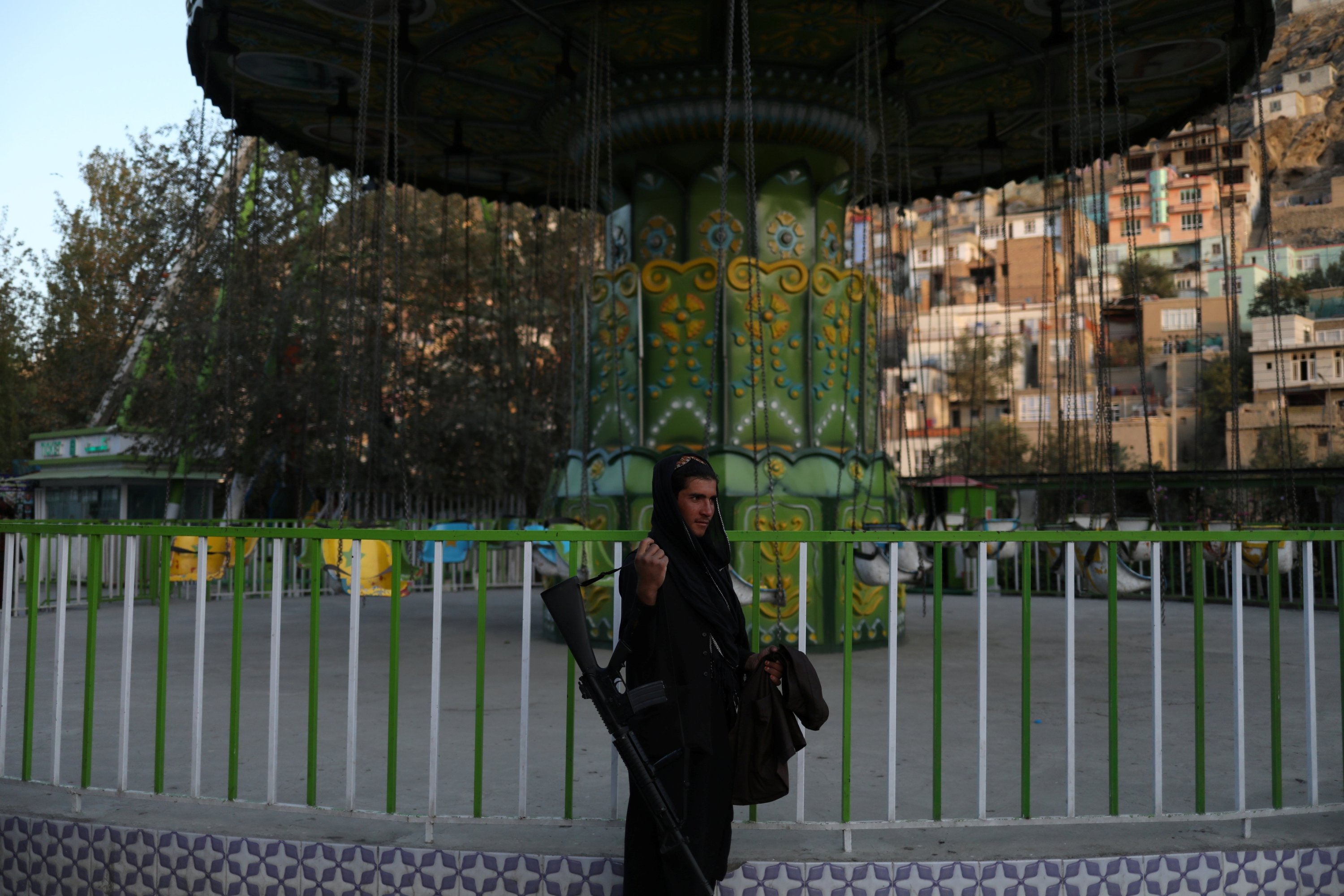 A Taliban soldier stands at an amusement park in Kabul, Afghanistan, Sept. 13, 2021. (REUTERS Photo)