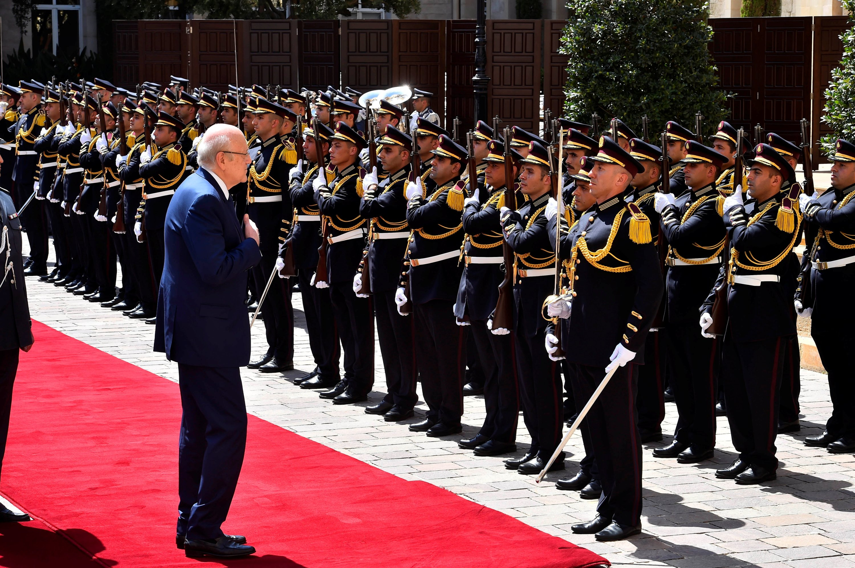 Lebanon's new Prime Minister Najib Mikati reviews an honor guard during an official ceremony to mark his assumption of duties at the Government Palace in Beirut, Lebanon, Sept. 13, 2021. (REUTERS Photo)