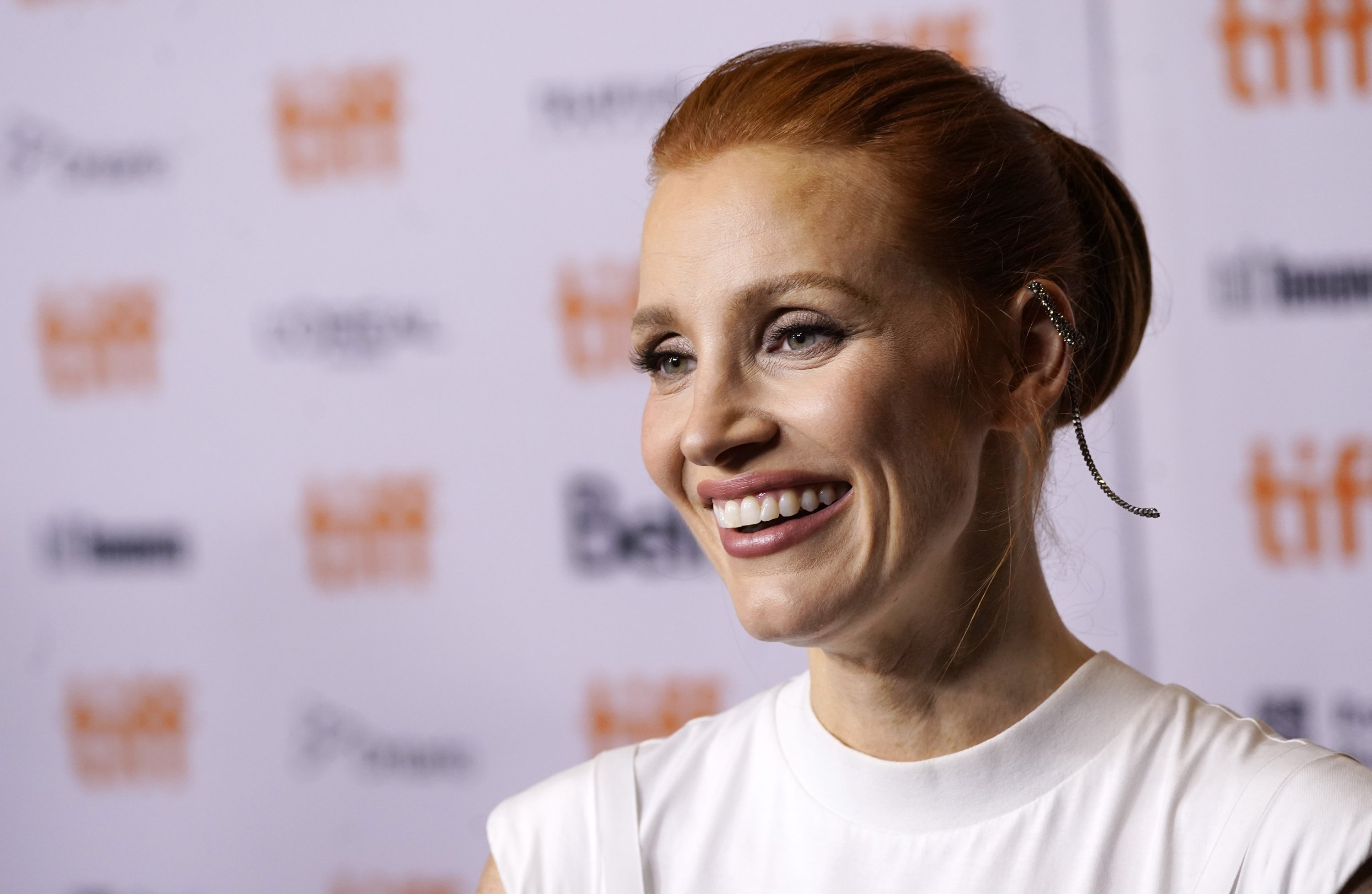 Jessica Chastain, a cast member in 'The Eyes of Tammy Faye,' smiles at the premiere of the film at the 2021 Toronto International Film Festival, Toronto, Canada, Sept. 12, 2021. (AP Photo)