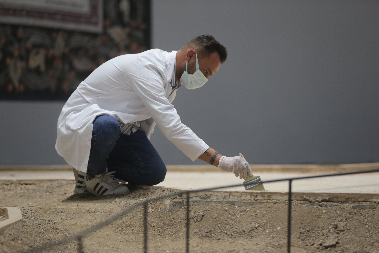 An expert works on a mosaic at the Şanlıurfa Archaeology Museum, southeastern Turkey, Sept. 12, 2021. (AA Photo)
