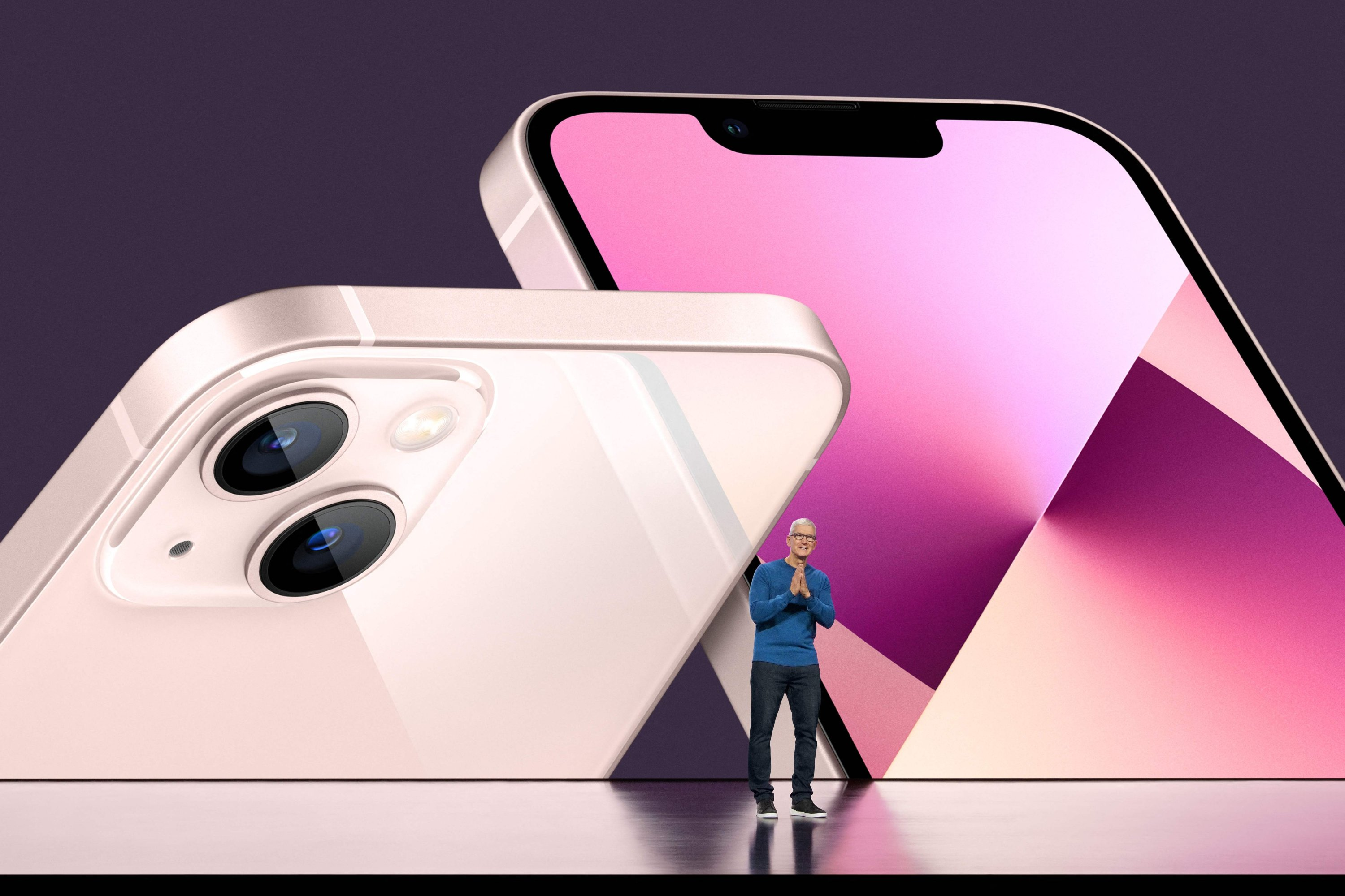 This handout image obtained courtesy of Apple Inc. shows Apple CEO Tim Cook unveiling the new iPhone 13 during a special event at Apple Park, Sept. 14, 2021.  (Photo by Brooks Kraft / Apple Inc. / AFP)