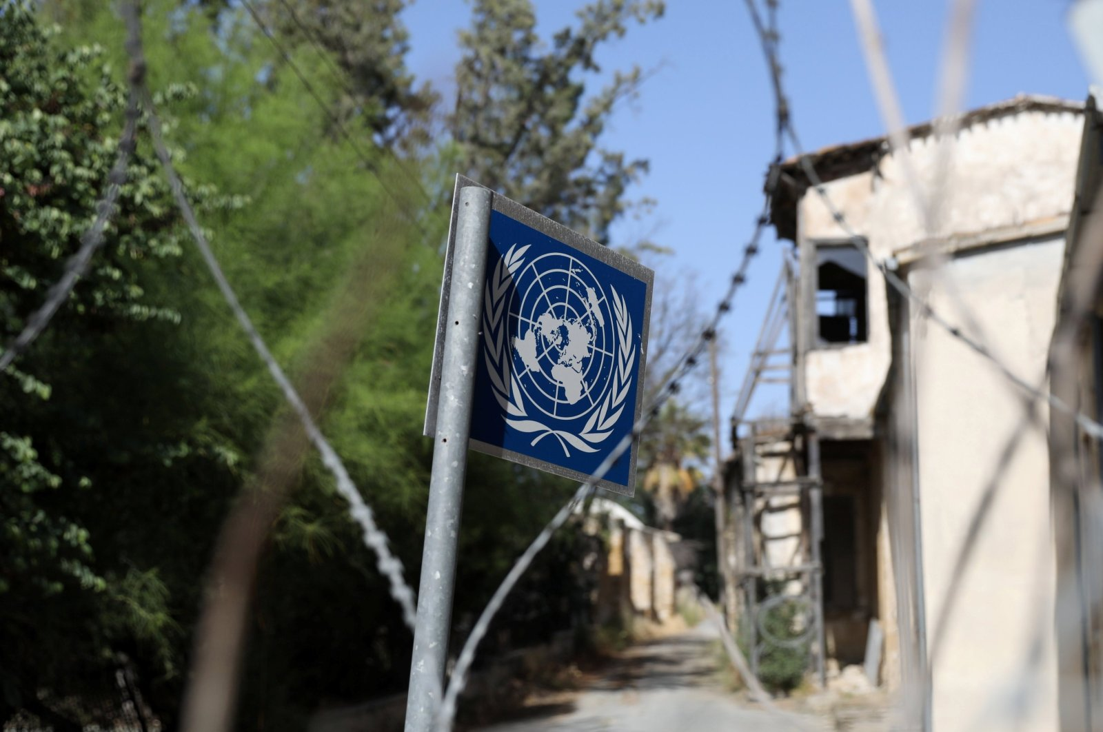 A United Nations sign stands in the U.N.-controlled buffer zone in Nicosia, on the island of Cyprus, April 28, 2021. (REUTERS)