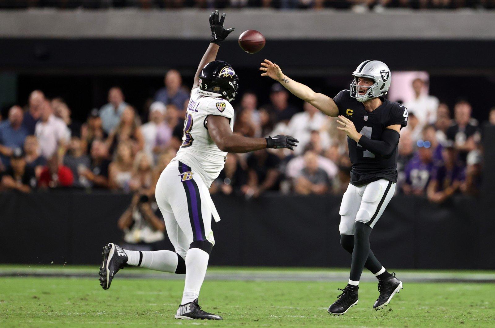 Derek Carr (4) of the Las Vegas Raiders makes a pass against the Baltimore Ravens at Allegiant Stadium, Las Vegas, Nevada, U.S., Sept. 13, 2021. (Getty Images via AFP)