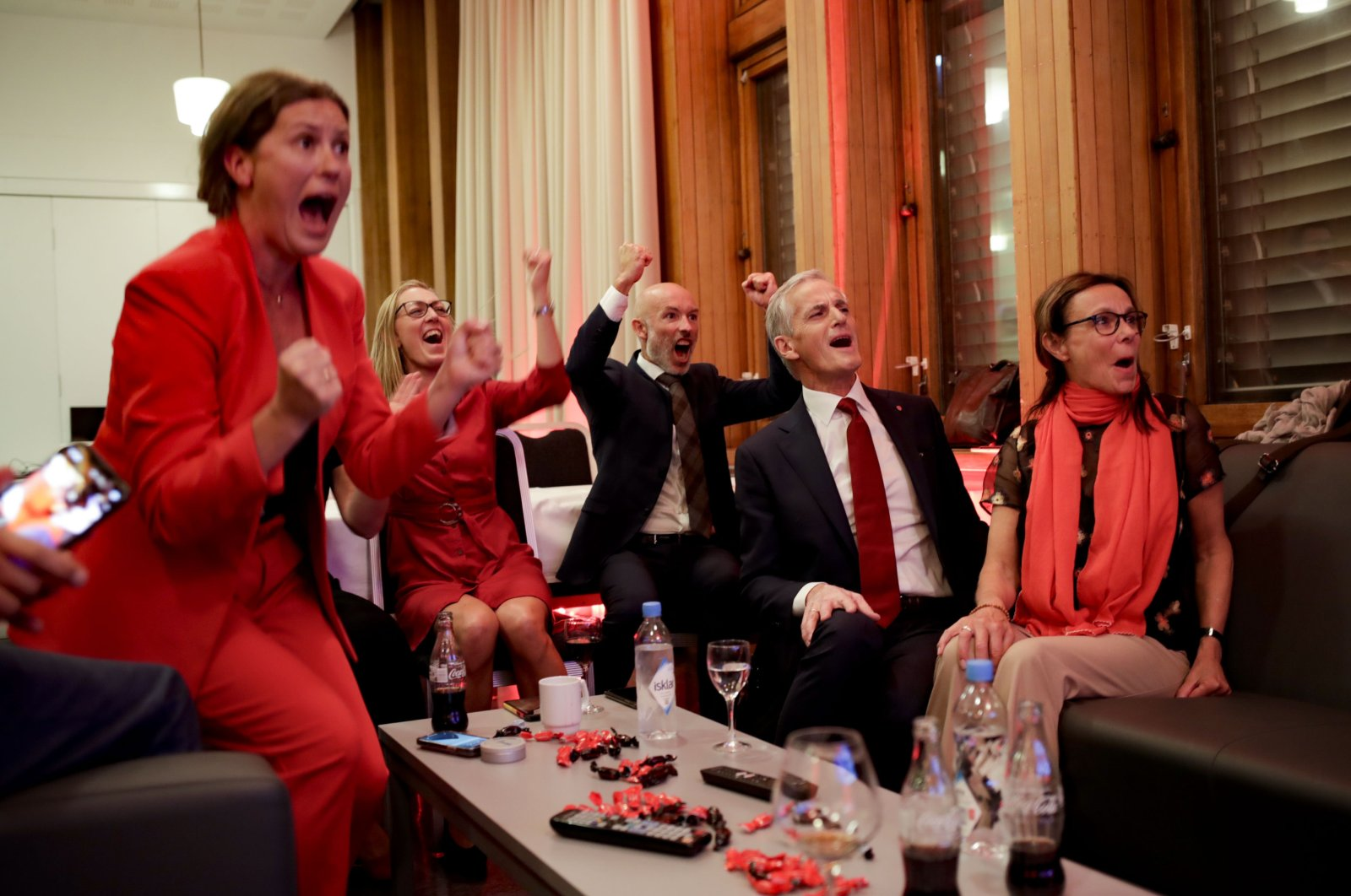 Labour leader Jonas Gahr Store cheers after seeing the exit poll during the Labour Party's election party at Folkets hus in the 2021 Norwegian parliamentary elections, in Oslo, Norway, Sept. 13, 2021. (AP Photo)