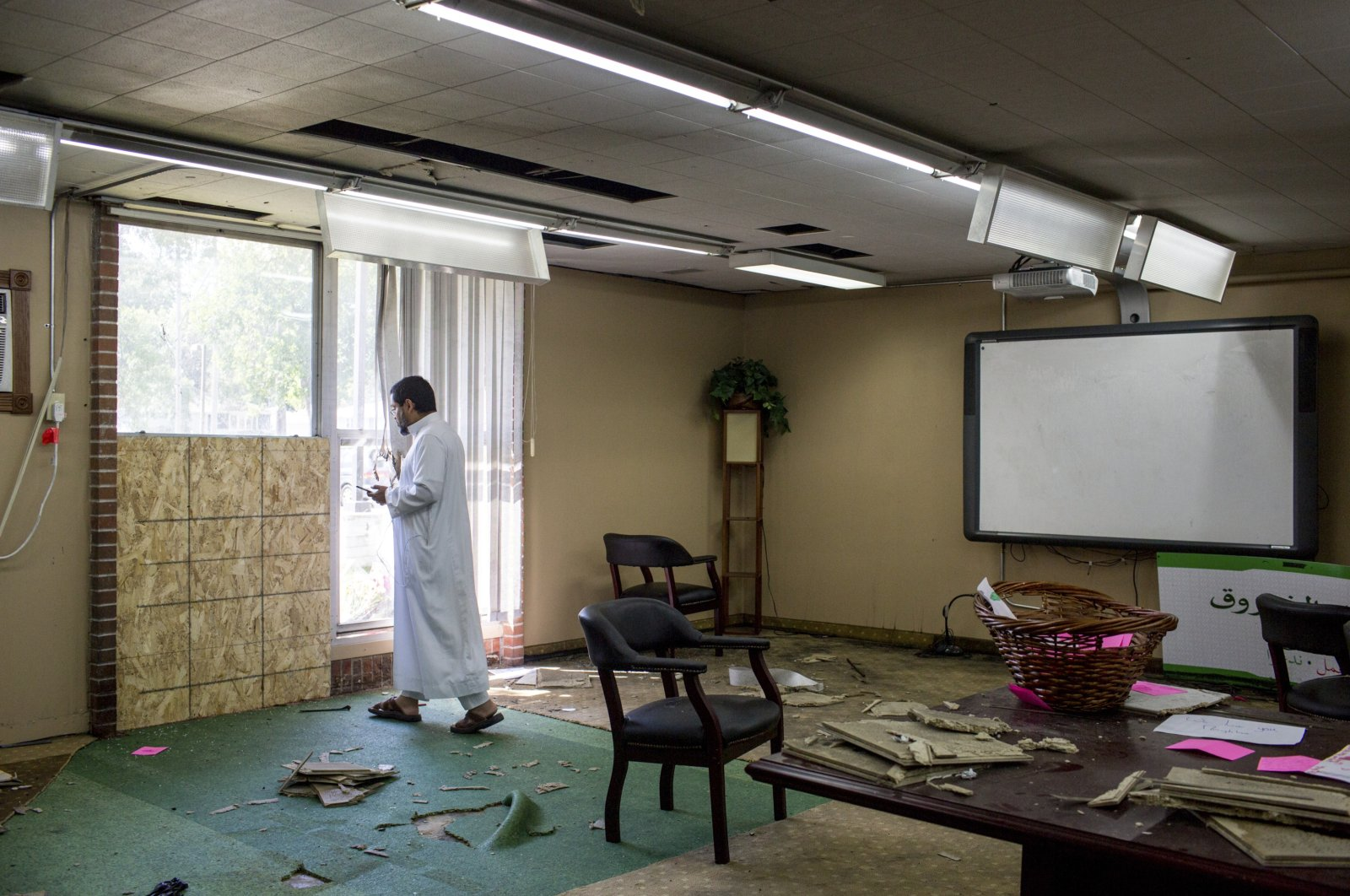 A man stands at the site of the bombing in the Dar Al Farooq Islamic Center in Bloomington, Minnesota, U.S., Aug. 7, 2017. (Star Tribune via AP)