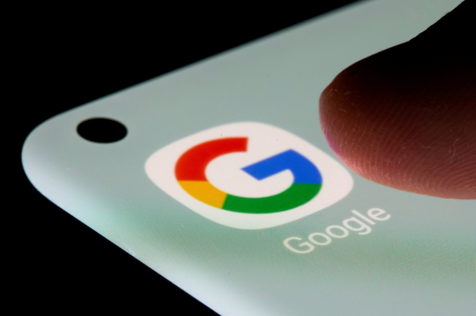 The Google app is seen on a smartphone in this illustration taken on July 13, 2021. (Reuters Photo)