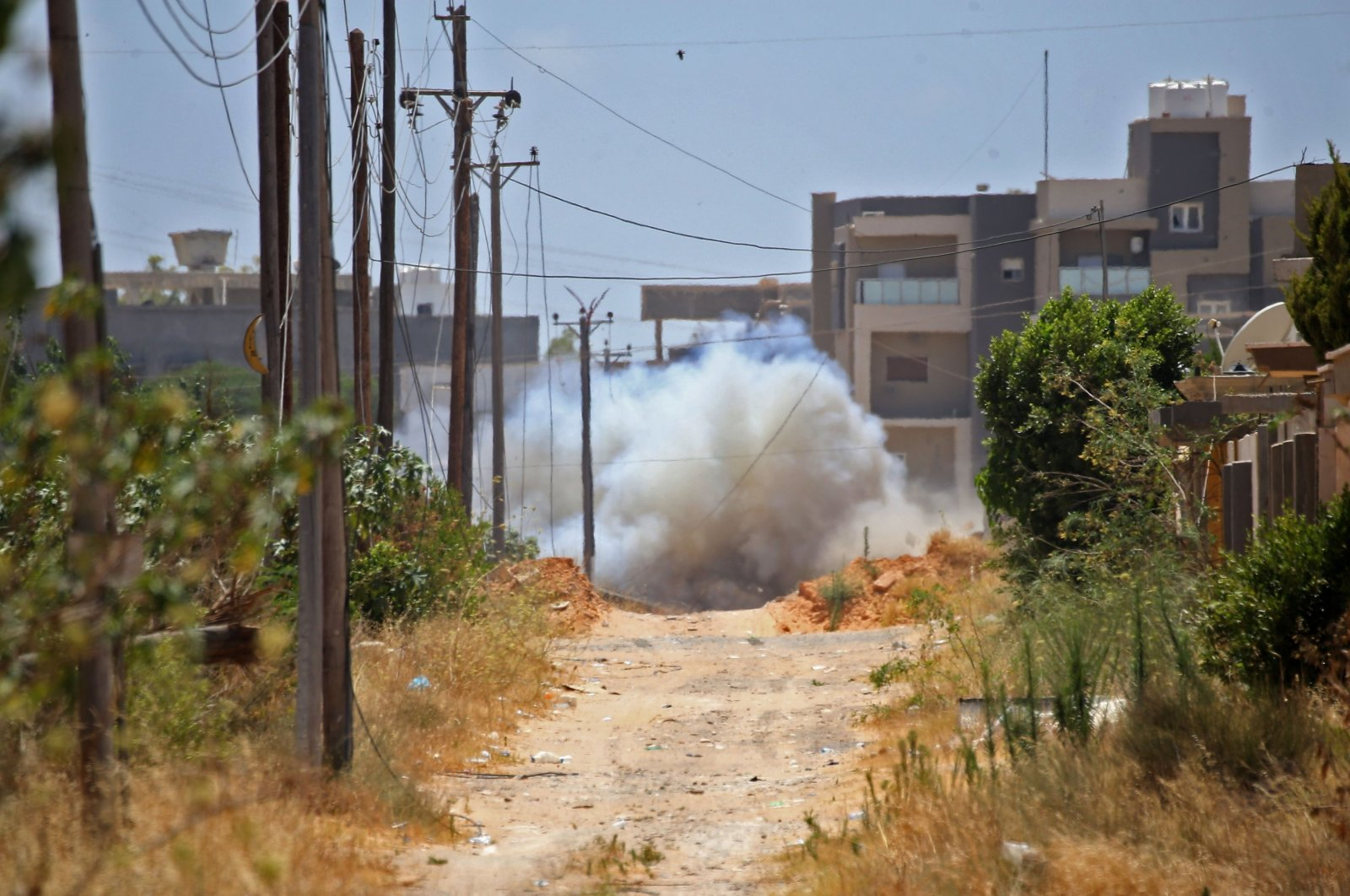 A land mine is destroyed in a controlled explosion during a Turkish demining operation in the Salah al-Din area, south of the capital Tripoli, Libya, June 15, 2020. (AFP Photo)