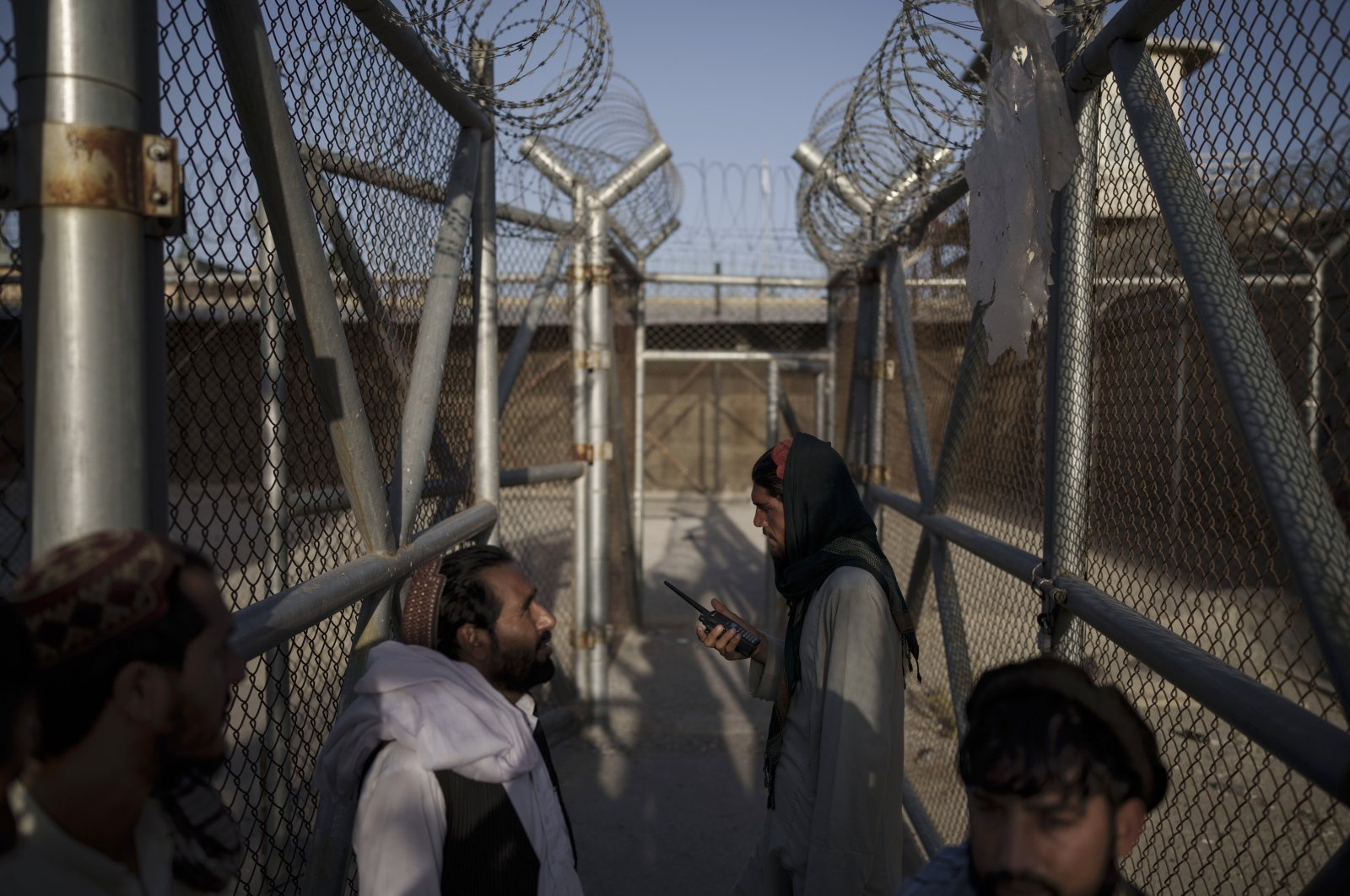 Taliban fighters enter an area where they are holding inmates who have been recently arrested at the Pul-e-Charkhi prison in Kabul, Afghanistan, Sept. 13, 2021. (AP Photo)