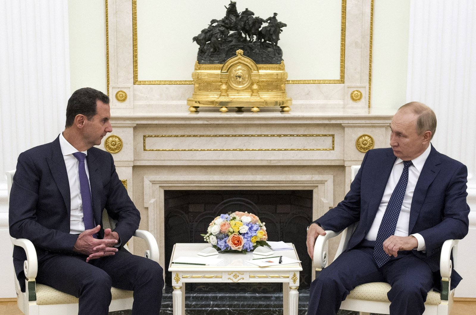 Russian President Vladimir Putin, right, listens to Syria's Bashar Assad during their meeting in the Kremlin in Moscow, Russia, Sept. 13, 2021. (Kremlin Pool Photo via AP)