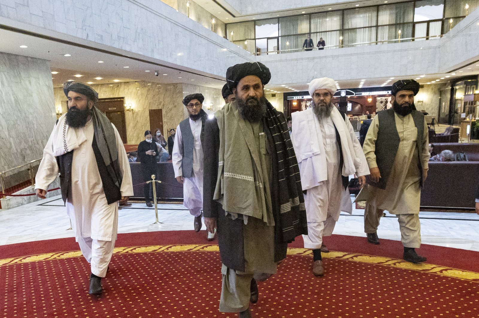 Taliban co-founder Mullah Abdul Ghani Baradar (C) arrives with other members of the Taliban delegation to attend an international peace conference in Moscow, Russia, March 18, 2021. (EPA-EFE Photo)