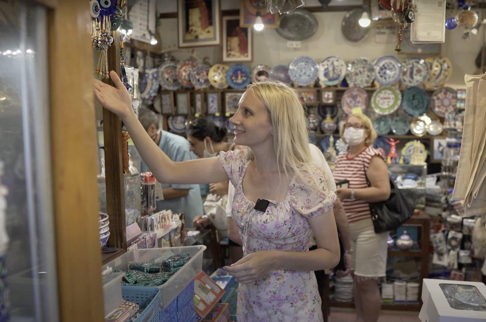 YouTuber Chelsea Elizabeth inspects items in a shop in Izmir, Turkey. (Photo from YouTube's Chelsea Elizabeth)