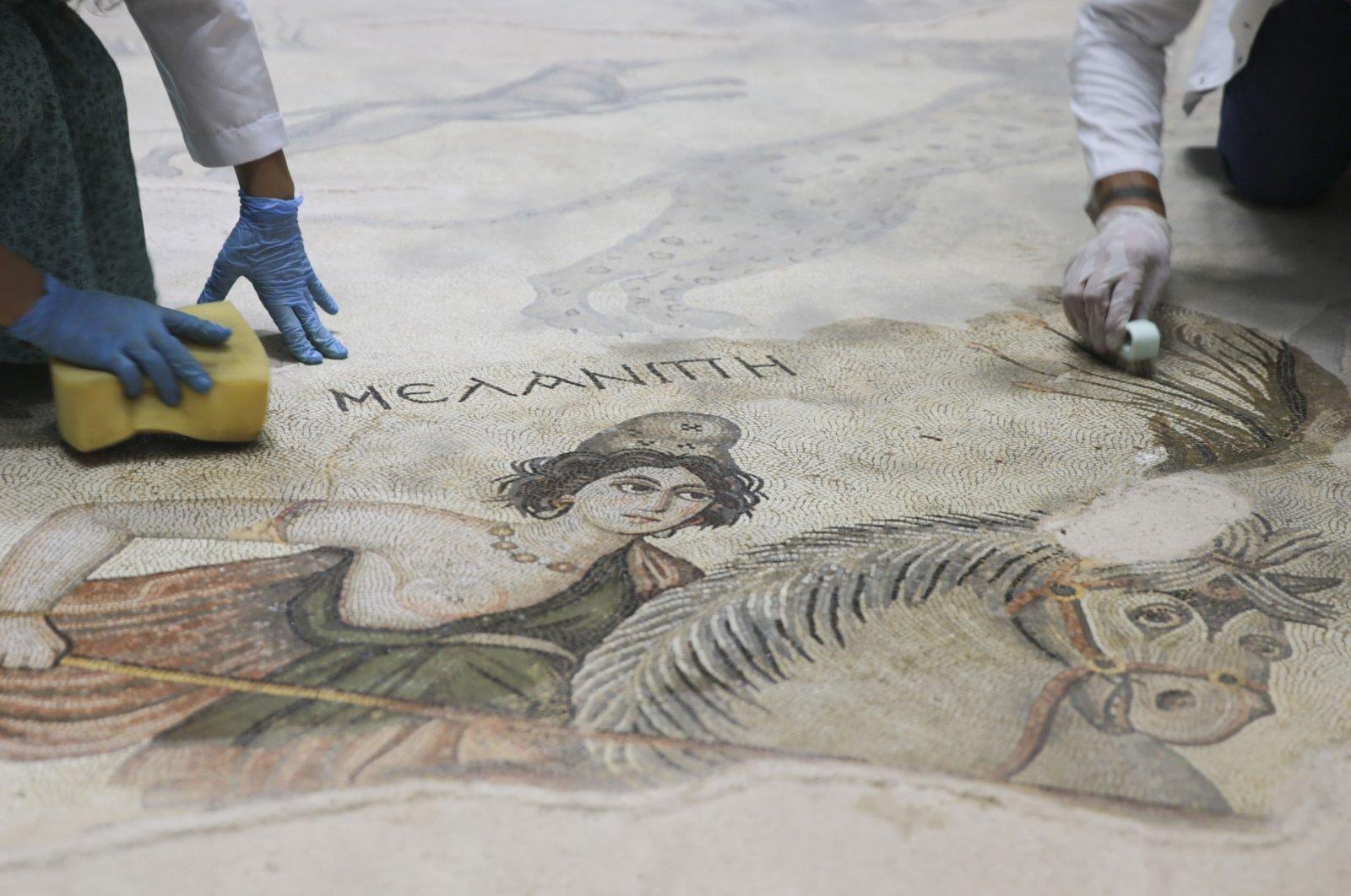 Experts work on a mosaic at the Şanlıurfa Archaeology Museum, southeastern Turkey, Sept. 12, 2021. (AA Photo)