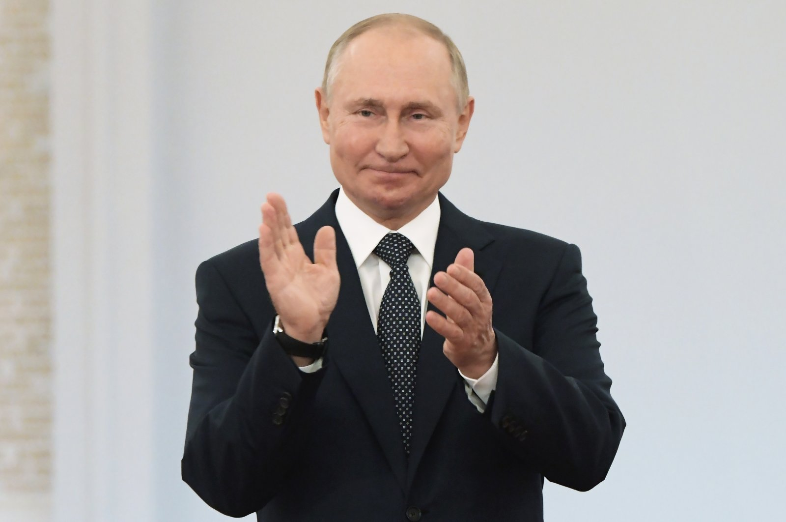 Russian President Vladimir Putin applauds during an awards ceremony for the Russian Olympic Committee's medalists of the Tokyo 2020 Summer Olympics in the Kremlin in Moscow, Russia, Sept. 11, 2021. (AP Photo)