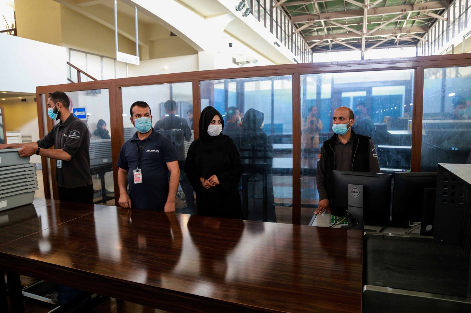Afghan airport staff work at the security check at Hamid Karzai International Airport in Kabul, Afghanistan, Sept. 13, 2021. (EPA Photo)