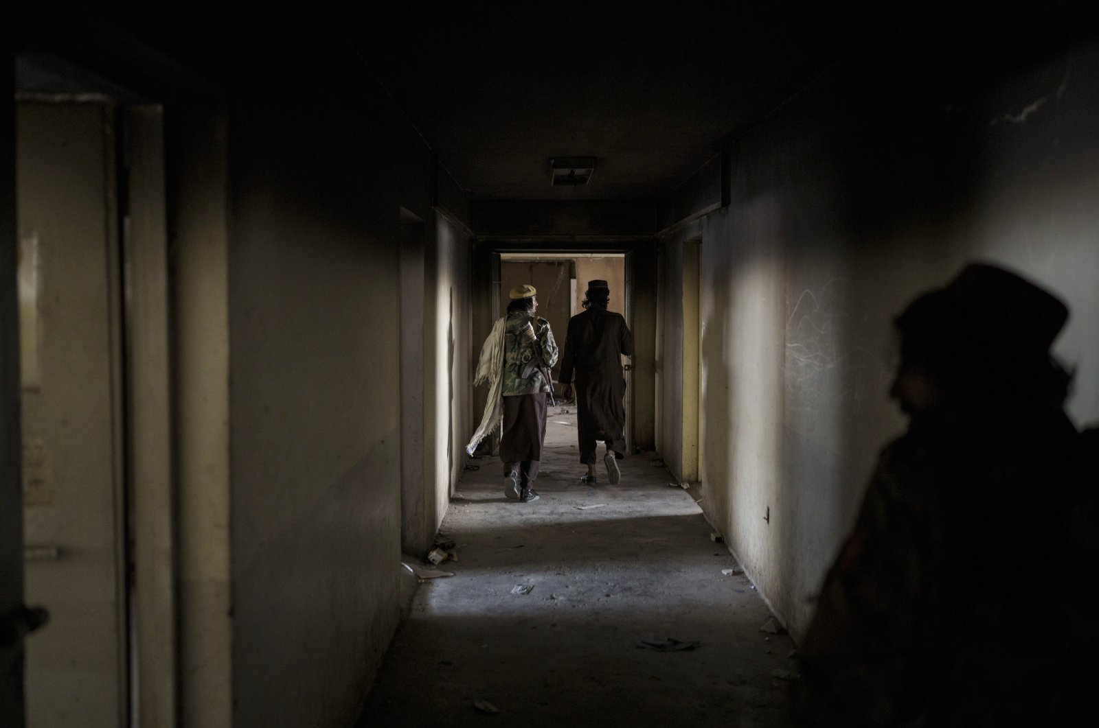 Taliban fighters walk through the alleys of an empty area at the Pul-e-Charkhi prison in Kabul, Afghanistan, Sept. 13, 2021. (AP Photo)