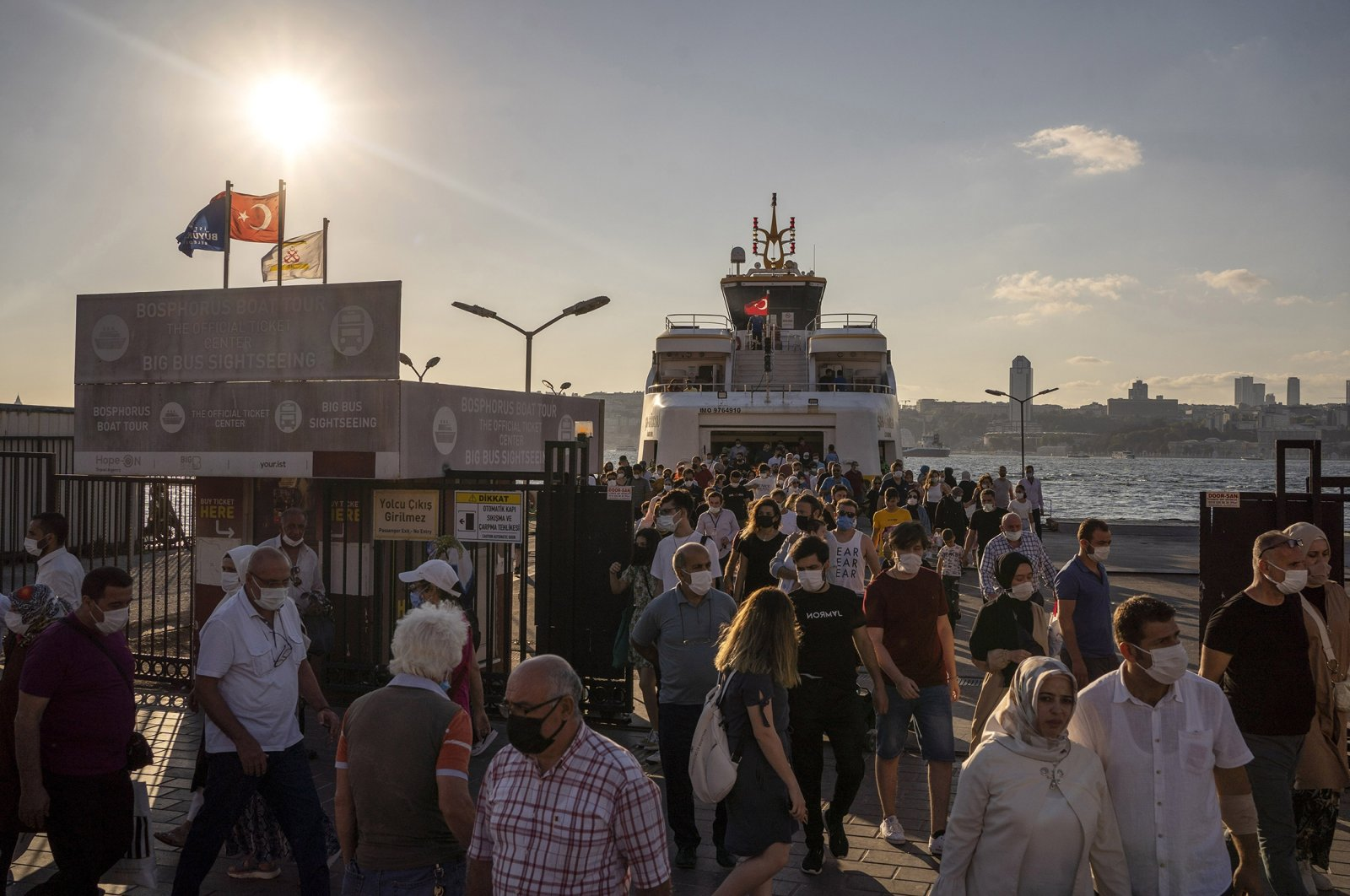 Passengers disembark from a tourist ferry at the docks on the Anatolian side, also known as the Asian side of Istanbul, Turkey, Aug. 16, 2021. (Getty Images Photo)