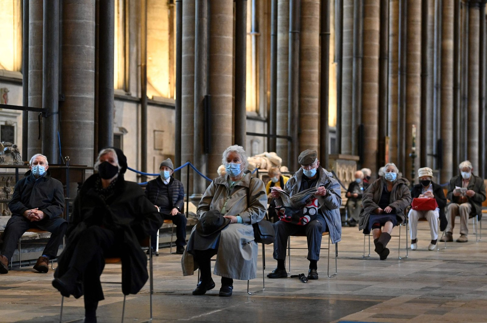 Members of the public sit socially distanced after receiving a dose of a COVID-19 vaccine at Salisbury cathedral, which has been converted into a temporary vaccination center in Salisbury, southwest England, Jan. 20, 2021. (AFP Photo)