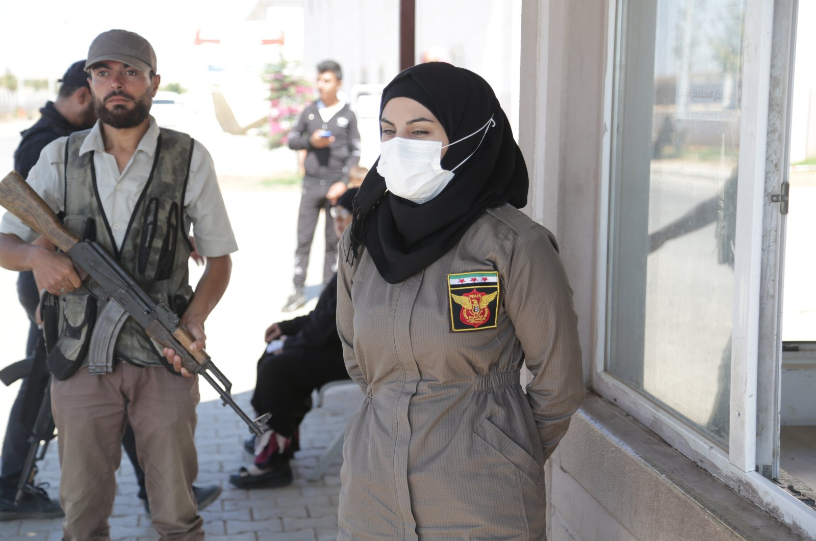 A policewoman stands at a checkpoint in al-Bab, Syria, Sept. 14, 2021. (AA PHOTO)