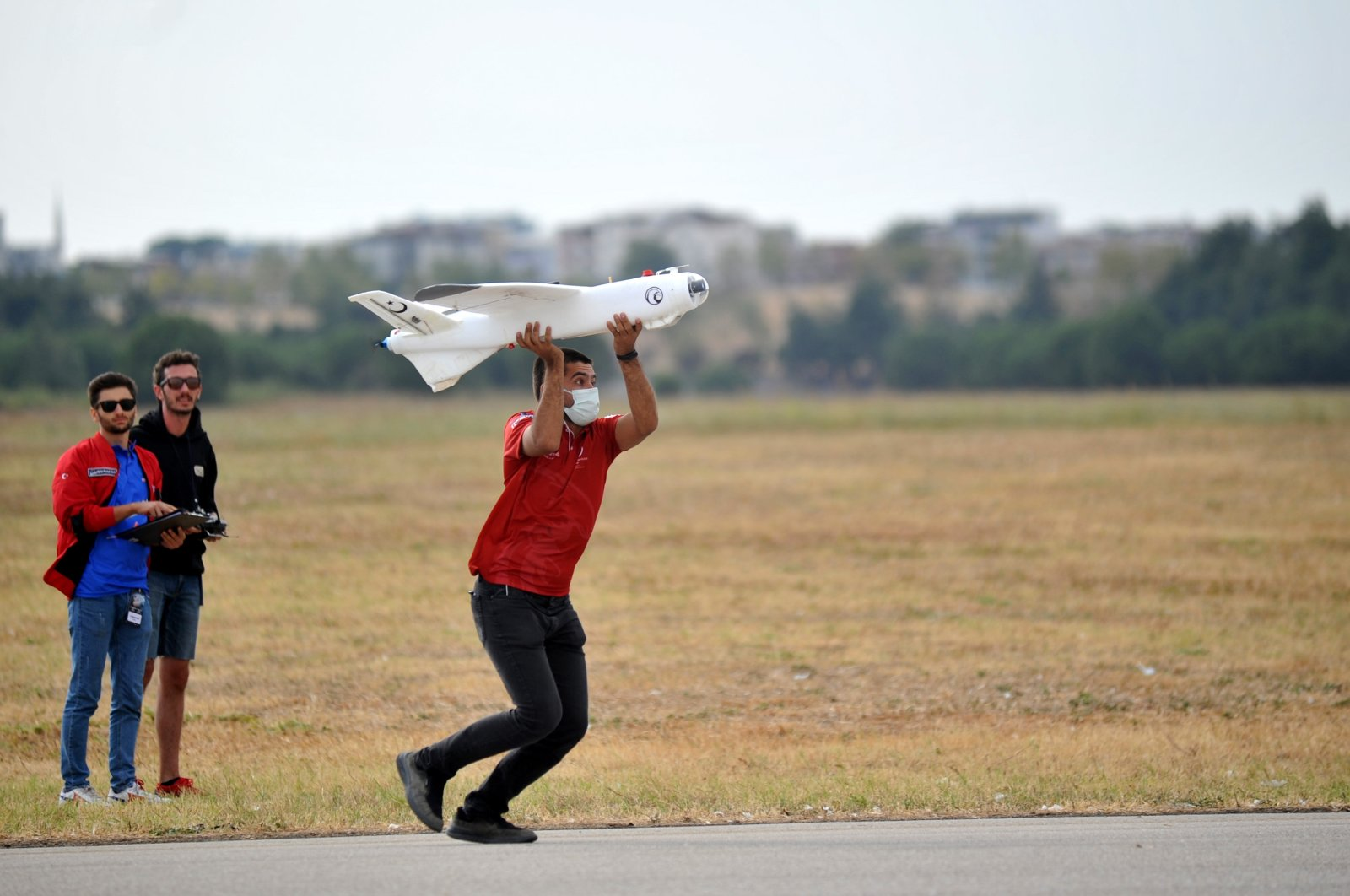 A student prepares to send up an unmanned aerial vehicle during a competitionas part ofTurkey's largest aerospace and technology event Teknofest in the northwestern province of Bursa, Turkey, Sept. 7, 2021. (DHA Photo)