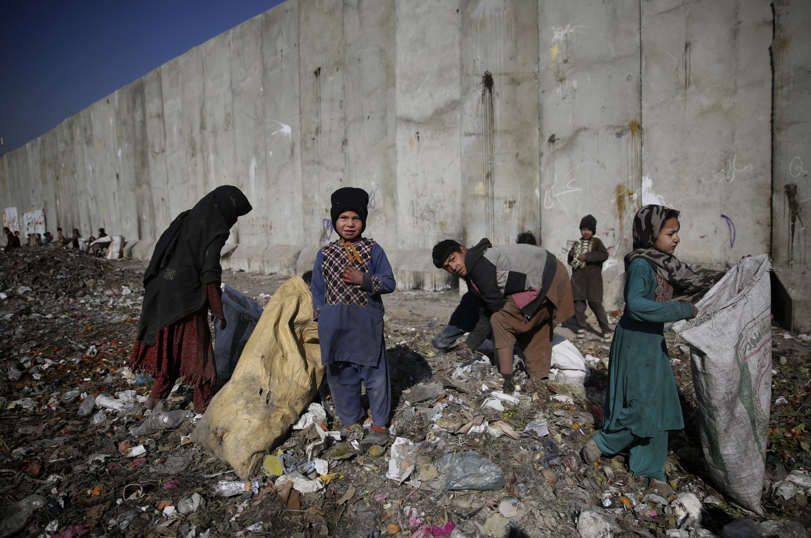Internally displaced Afghan children look for plastic and other items which could be used as a replacement for firewood, at a garbage dump in Kabul, Afghanistan, Sunday, Dec. 15, 2019. (AP File Photo)