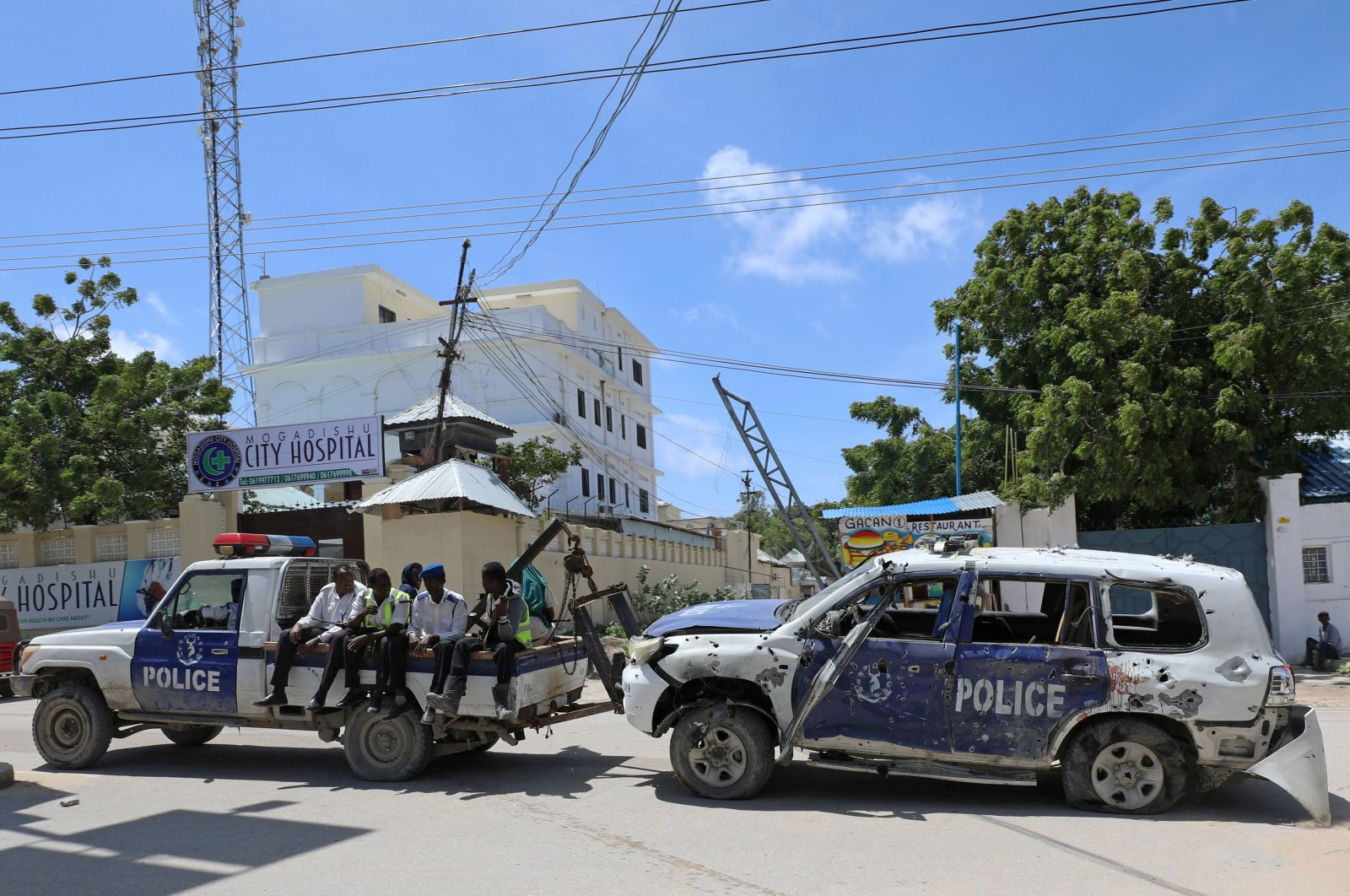 Somali police officers tow their car from the scene of a roadside explosion in Hodan district of Mogadishu, Somalia, July 8, 2020. (Reuters File Photo)