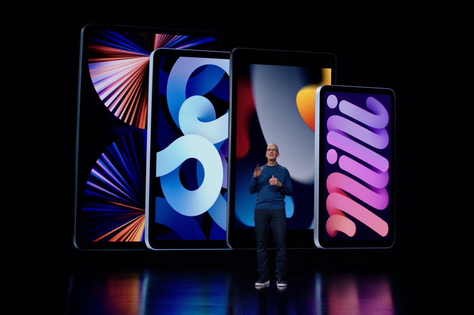 This handout image obtained courtesy of Apple Inc. shows Apple CEO Tim Cook introduces the latest iPad and iPad mini to the iPad lineup during a special event at Apple Park, as seen in this still image from the keynote video,  Sept. 14, 2021. (Photo by Handout / Apple Inc. / AFP)