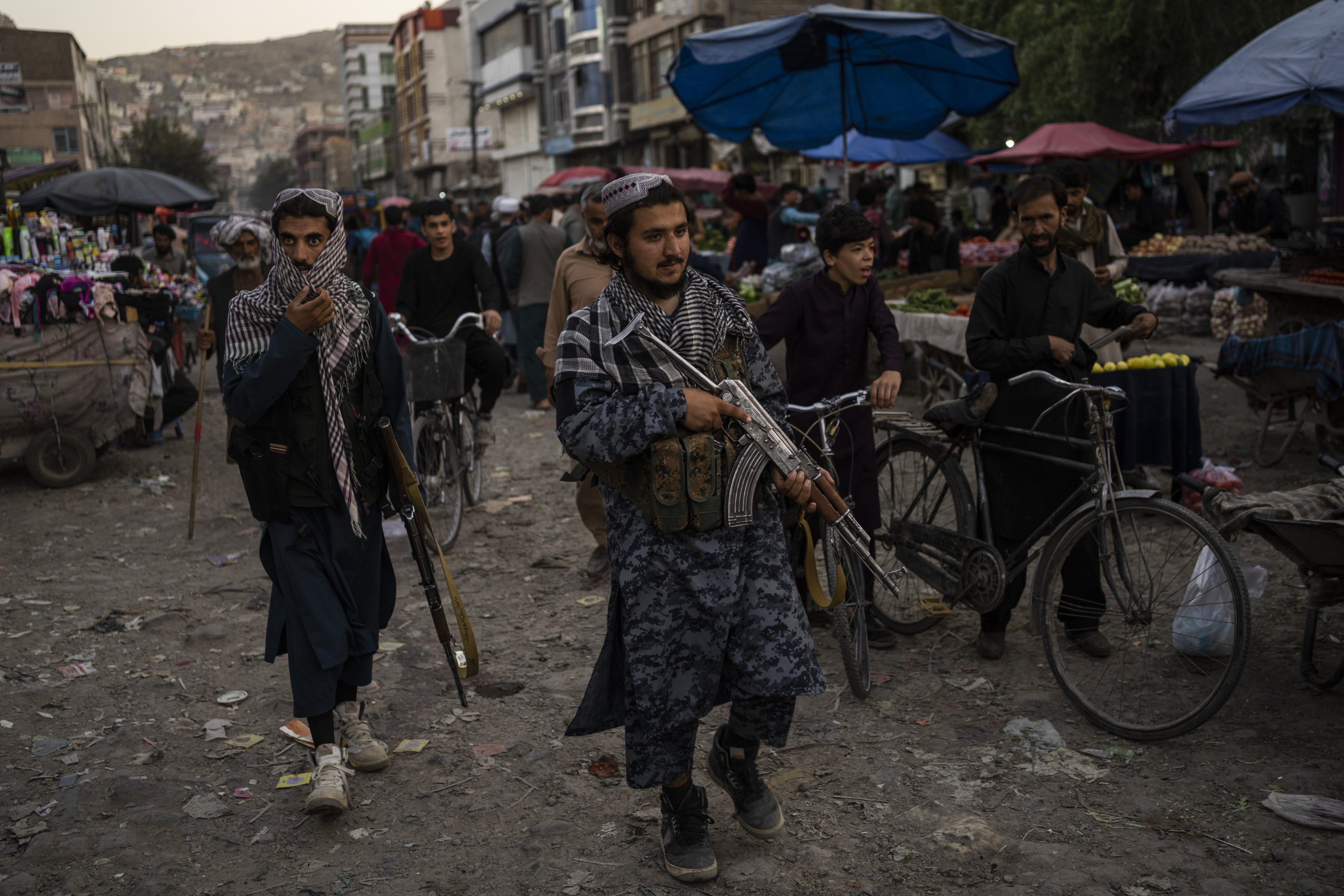 Taliban fighters patrol a market in Kabul, Afghanistan, Sept. 14, 2021. (AP Photo)