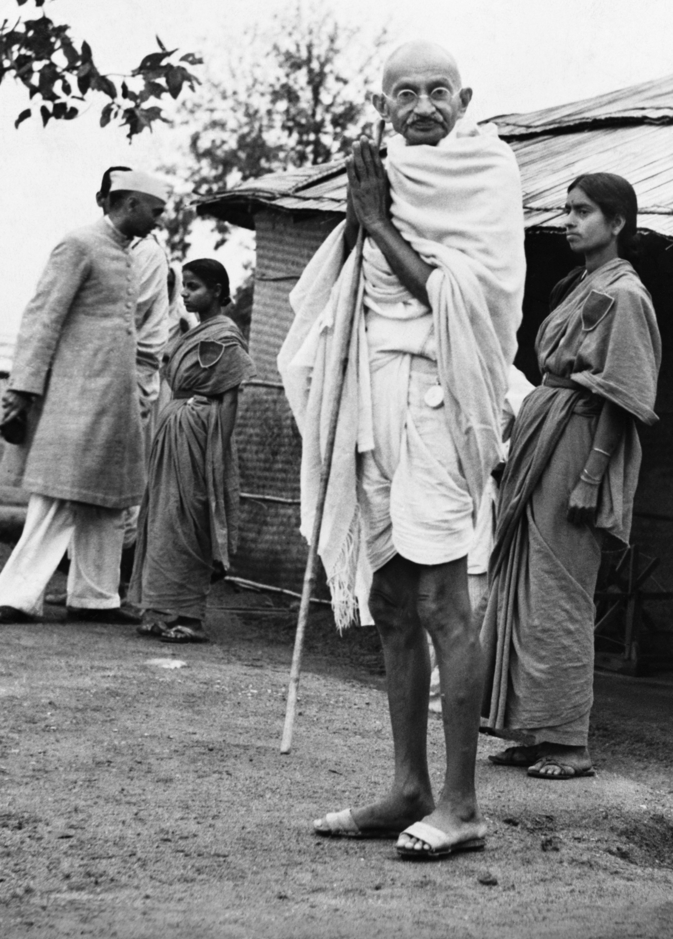 Mahatma Gandhi gives the namaste gesture, acknowledging the greetings of supporters, India, March 25, 1940. (Photo by Getty Images)