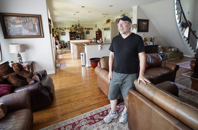 Antonio Fernandez, 64, poses in his house in Bellaire, Texas, U.S., Sept. 9, 2021. (AFP Photo)